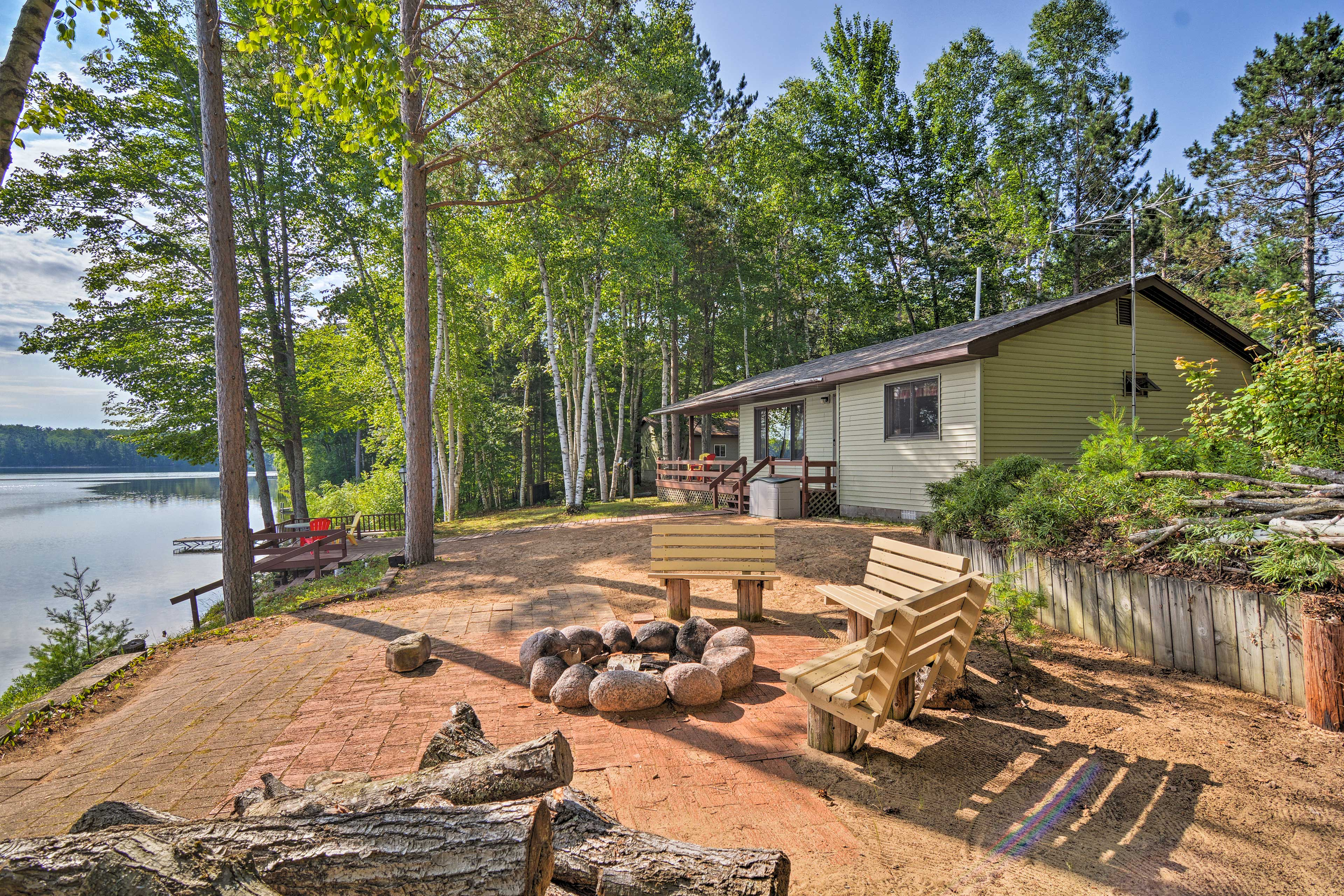 The cabin boasts 2 bedrooms and 1 bathroom with a beach, dock and fire pit.