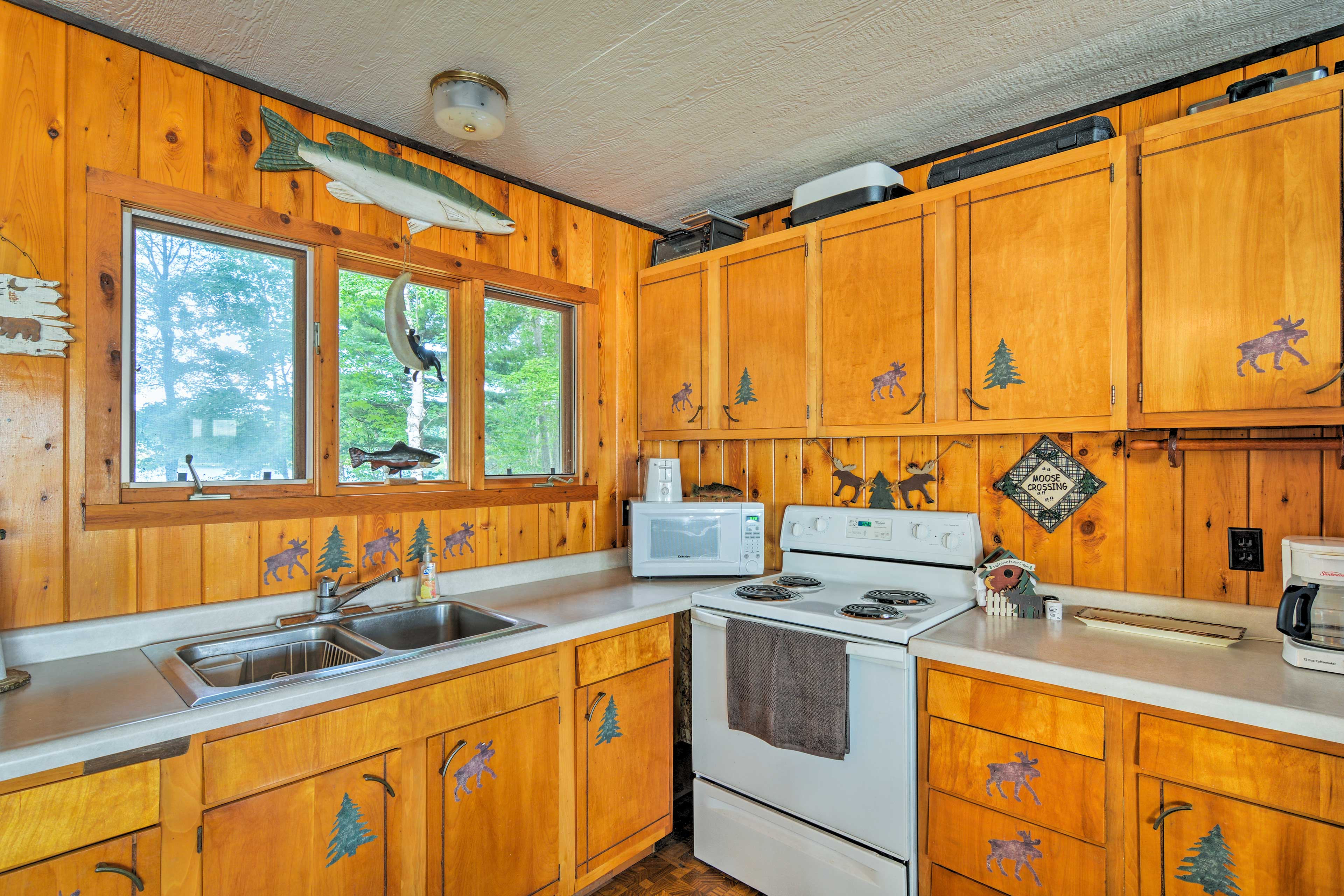 Wooden cabinets provide storage space and hold cooking utensils.