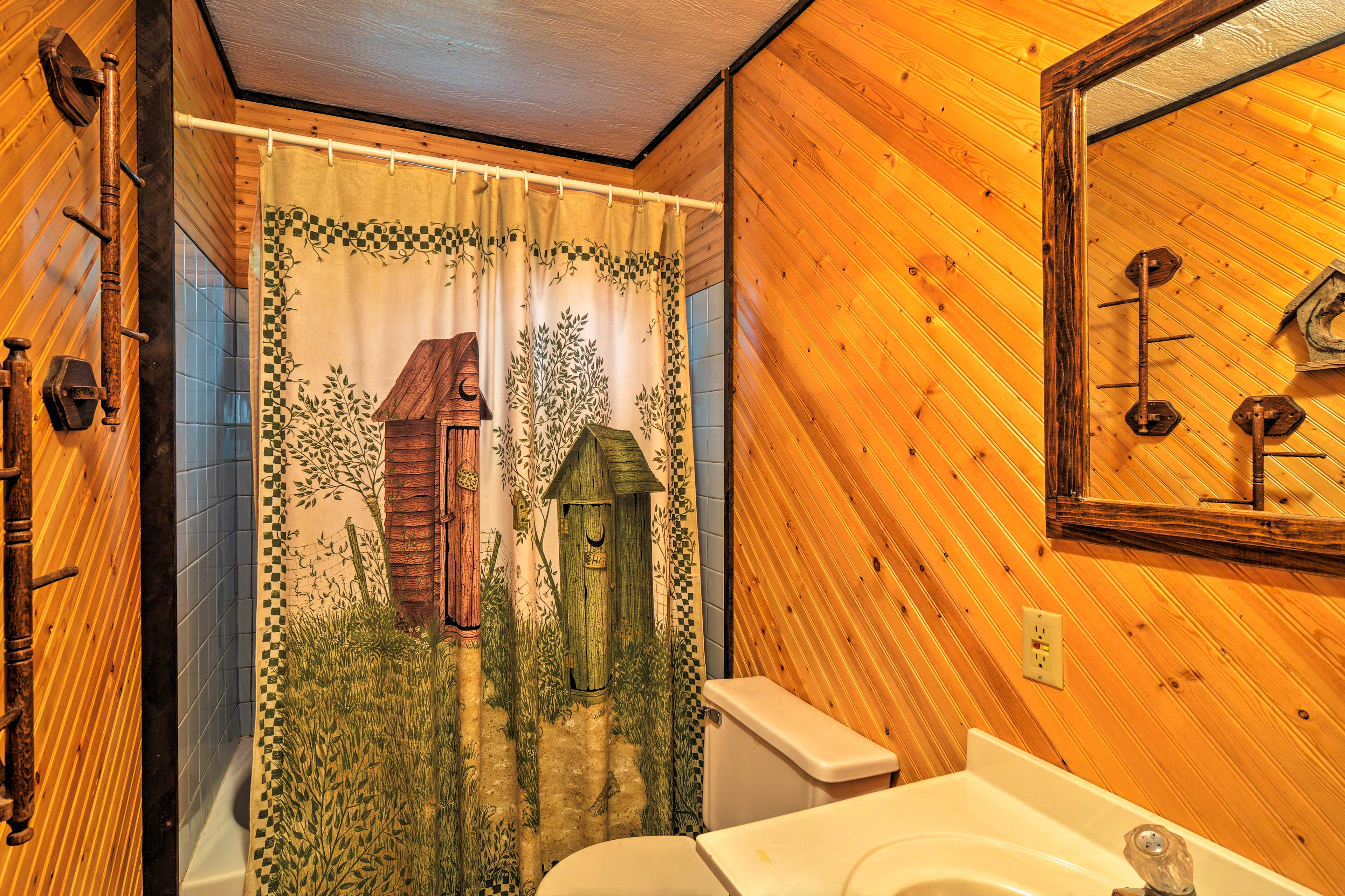 The full bathroom is furnished with a shower/tub combo.