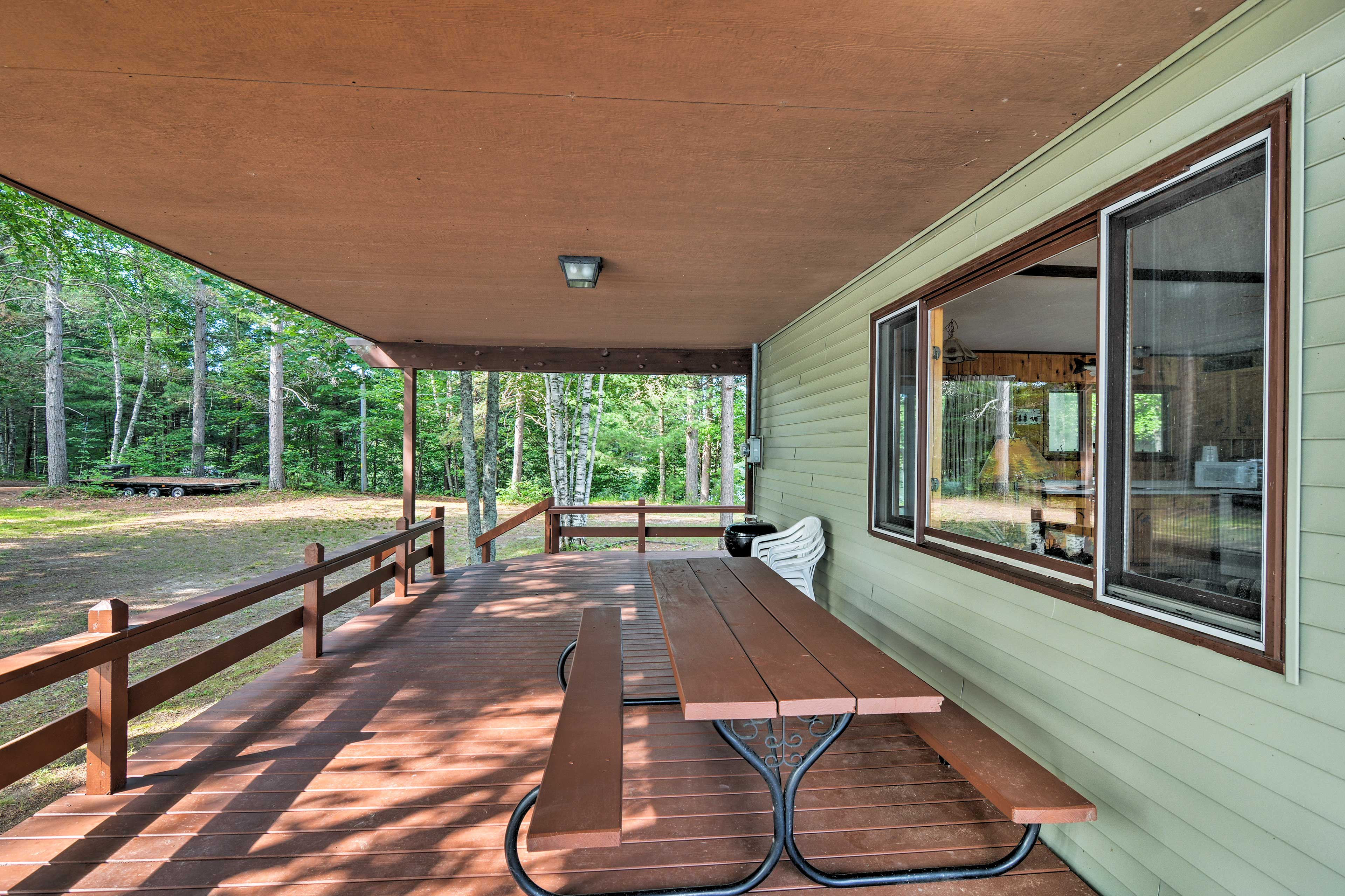 The spacious deck is covered so you can enjoy it in all weather conditions.