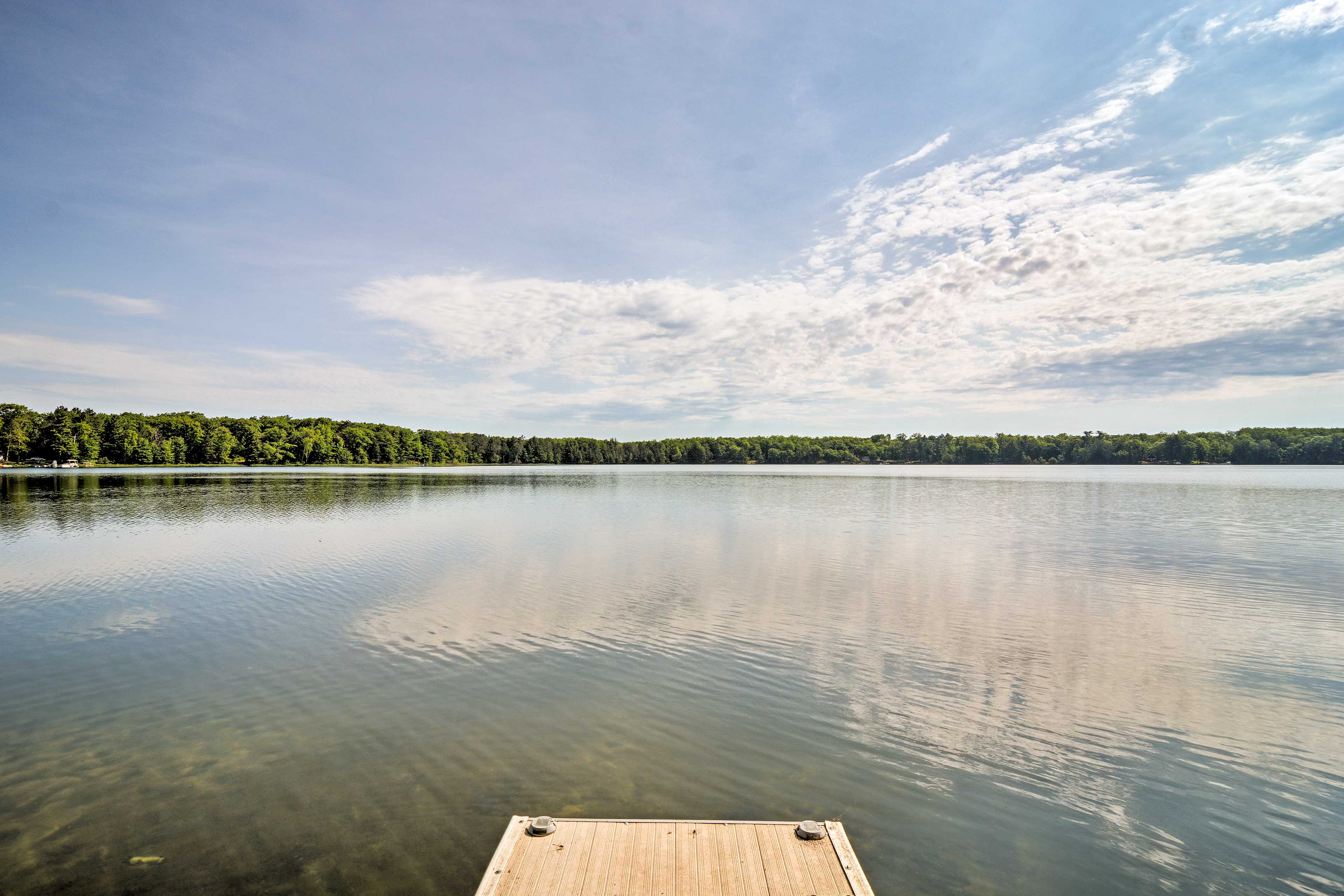 Gooseneck Lake's crystal clear waters beckon you to waste the day away.