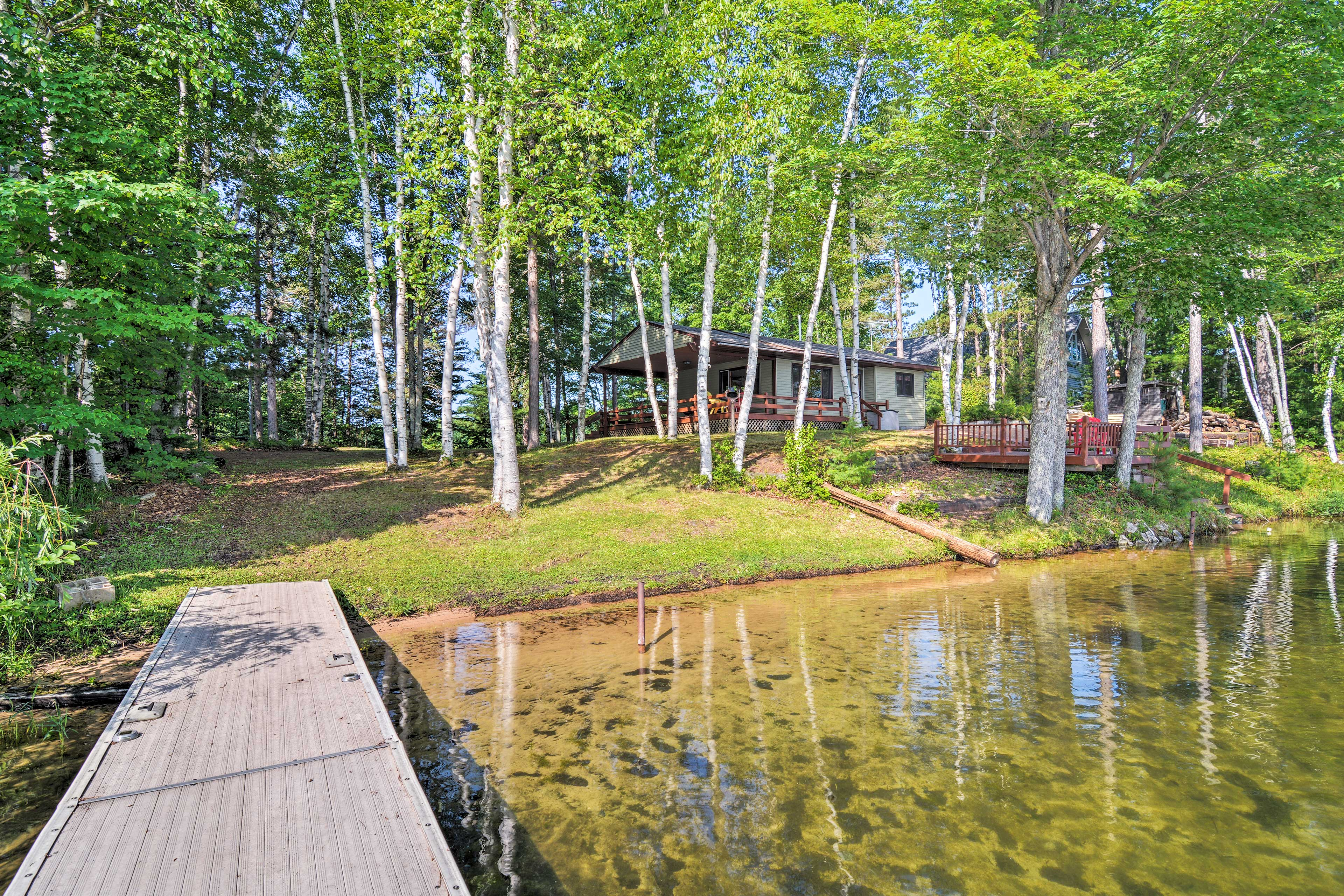 The cabin is nestled in the trees of Hiawatha National Forest.