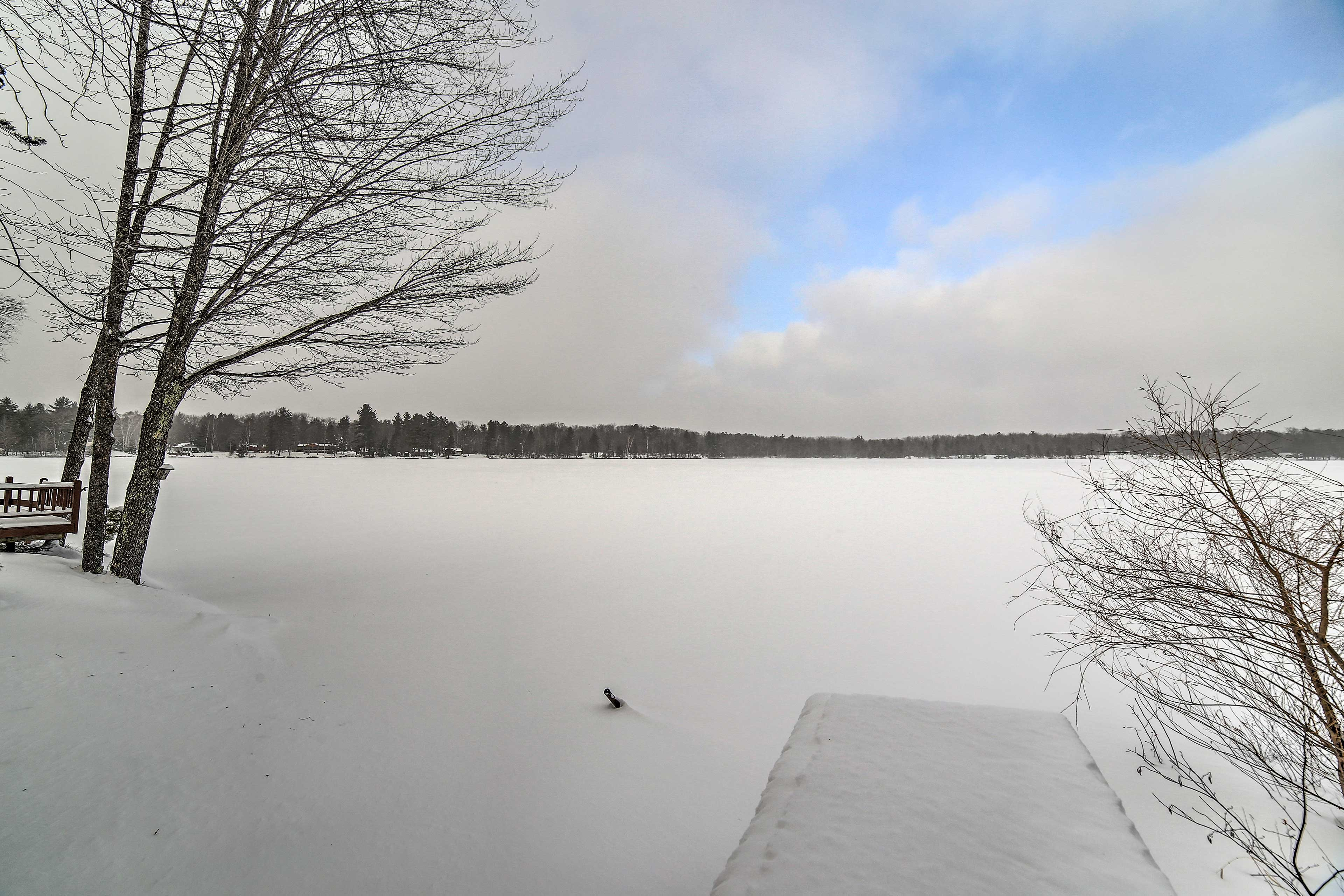 The lake freezes over and turns into a winter wonderland.