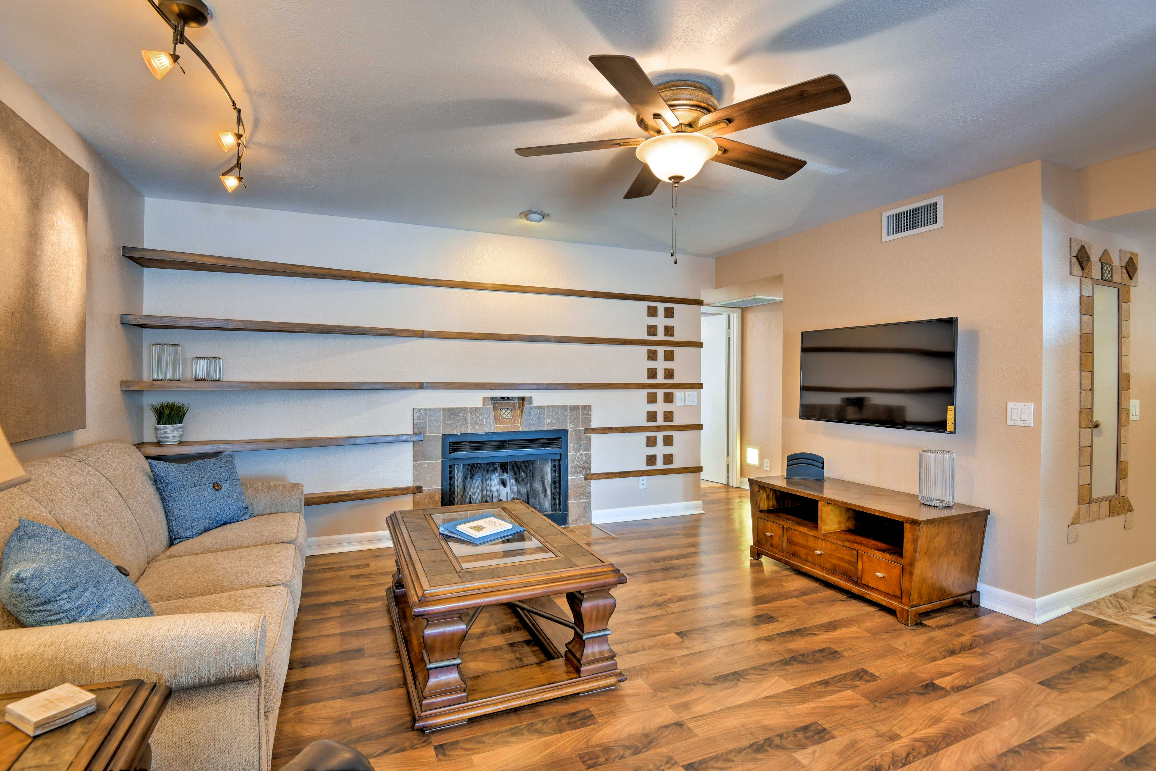 The space features a wood-burning fireplace and flat-screen Smart satellite TV.