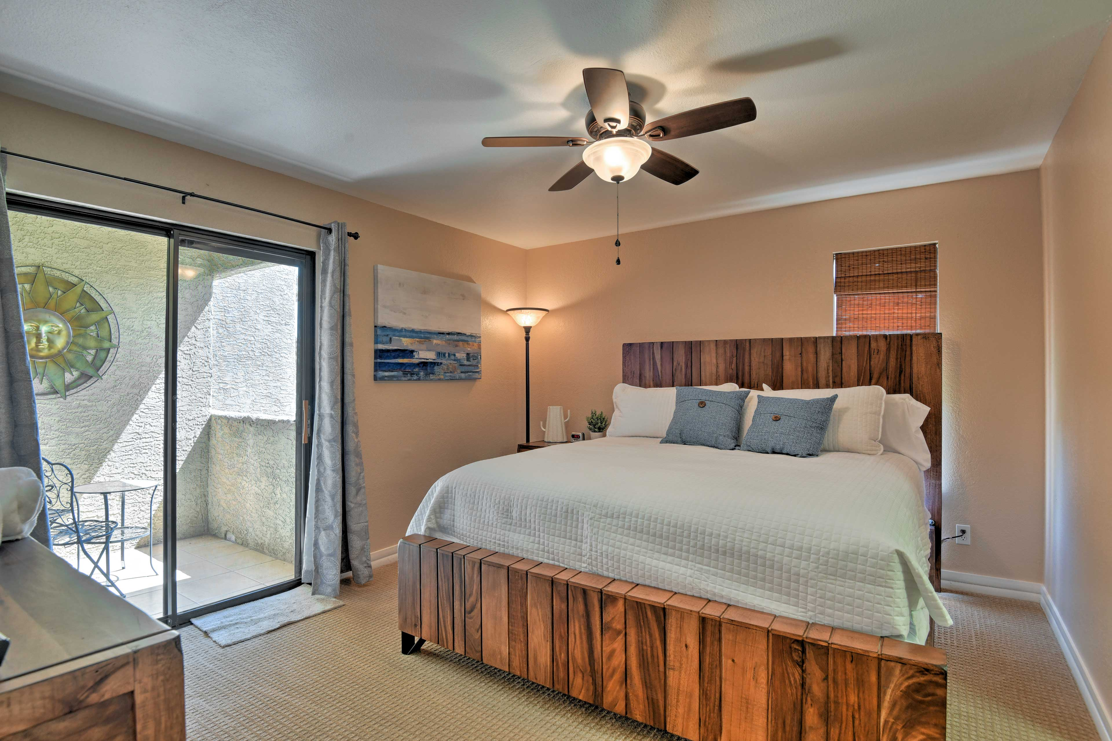 Fall back on the comfy king bed in the first master bedroom.