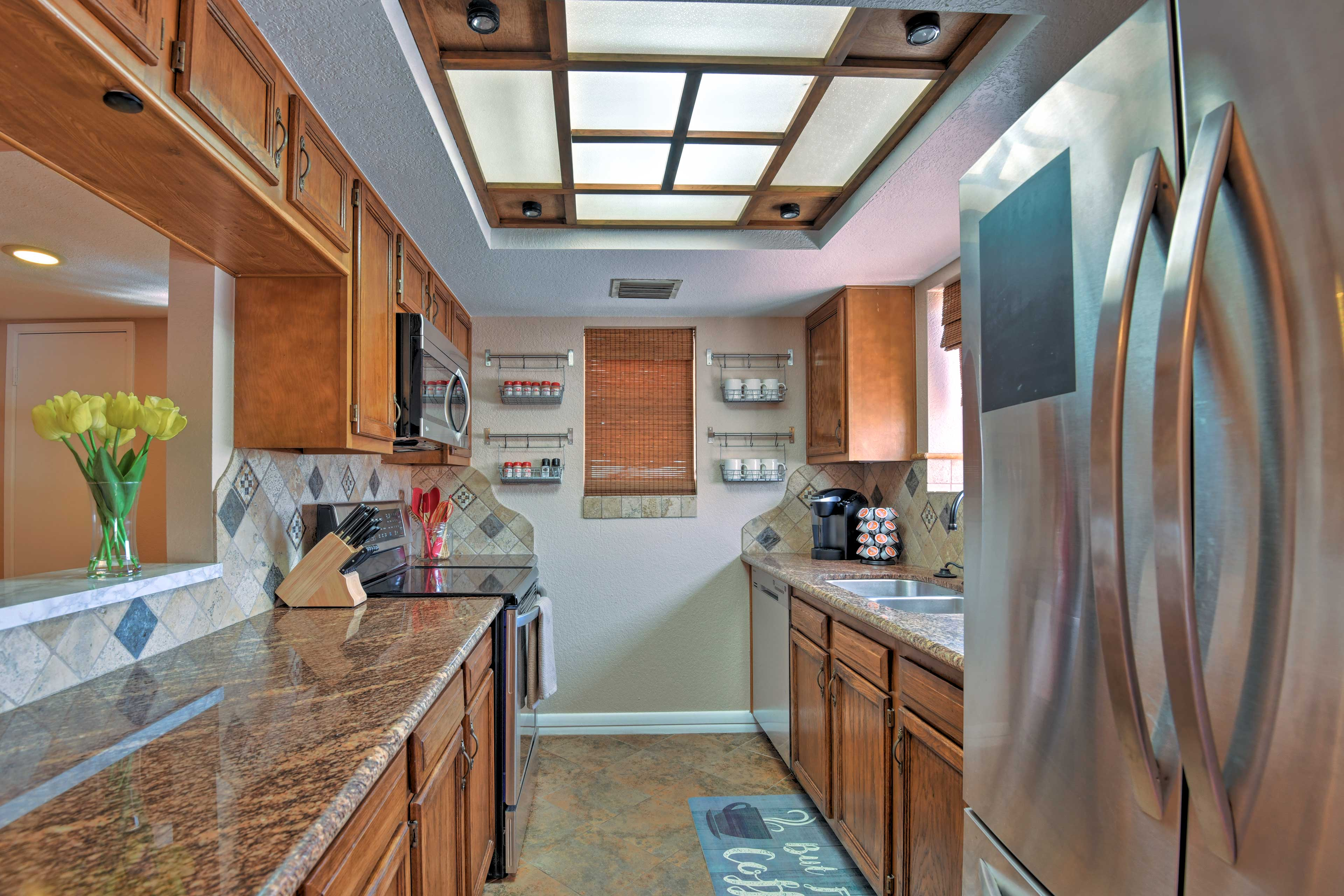 The galley-style fully equipped kitchen is perfect for at-home cooking.