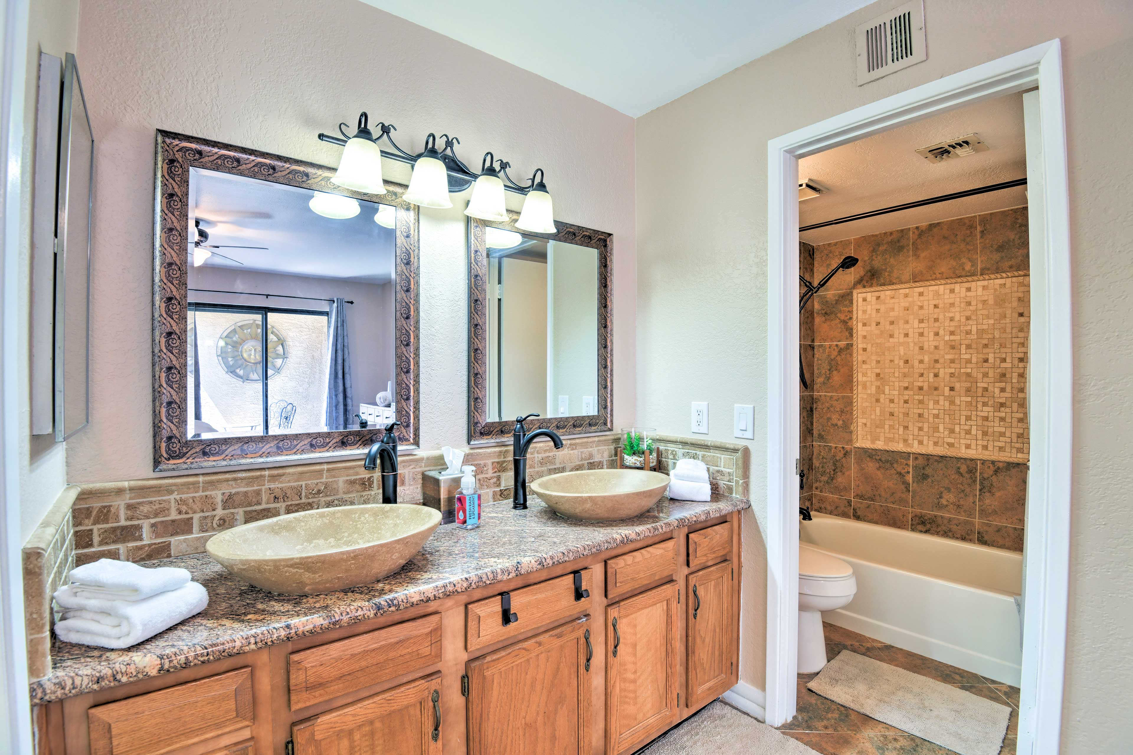 Enjoy the added luxury of an en-suite bathroom with a shower/tub combo.