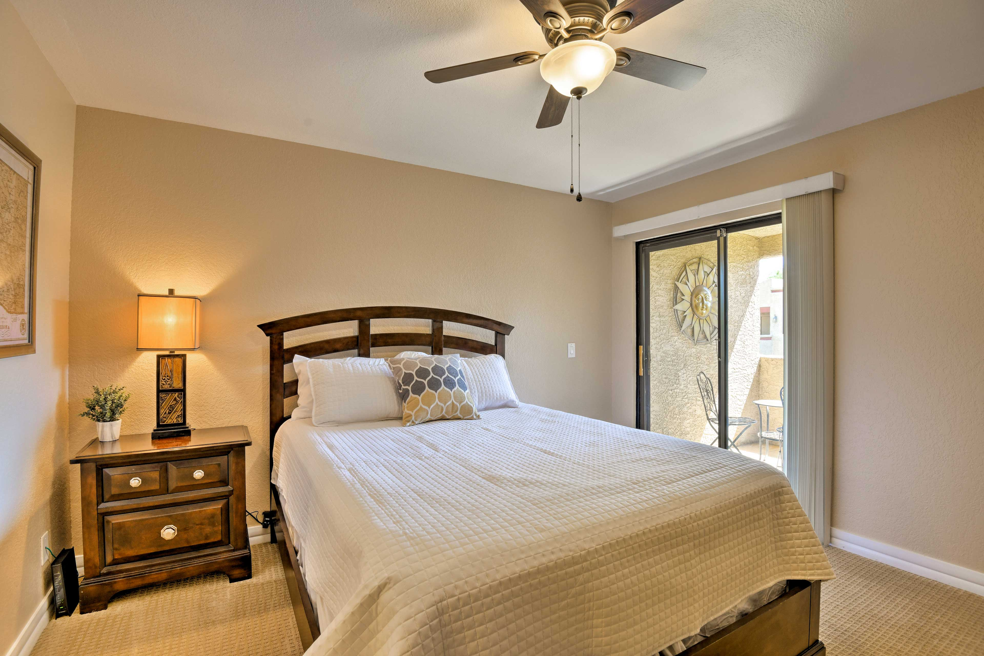 You'll find a queen-sized bed in the second master with patio access.