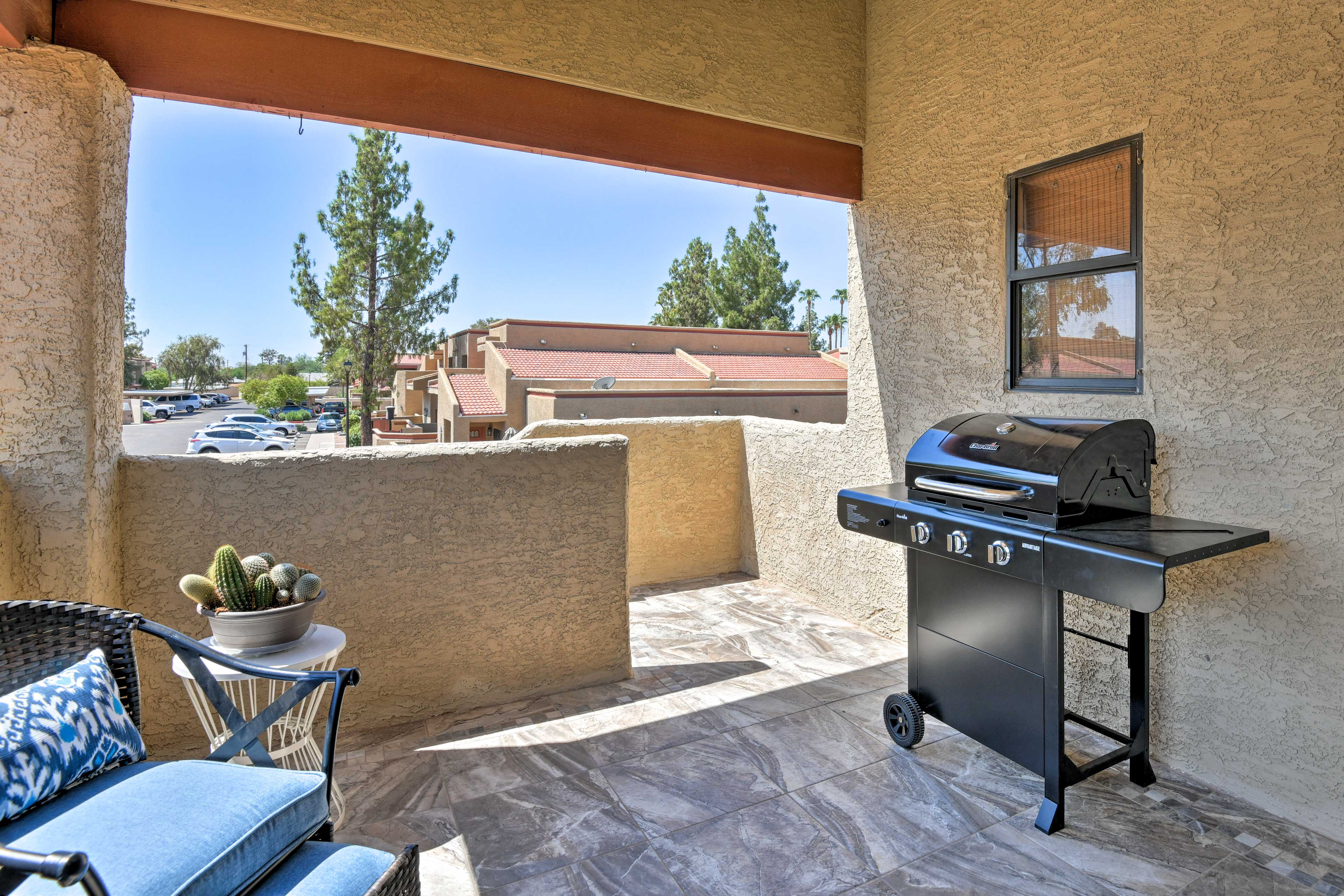 Throw some burgers on the gas grill for lunch on the covered patio.