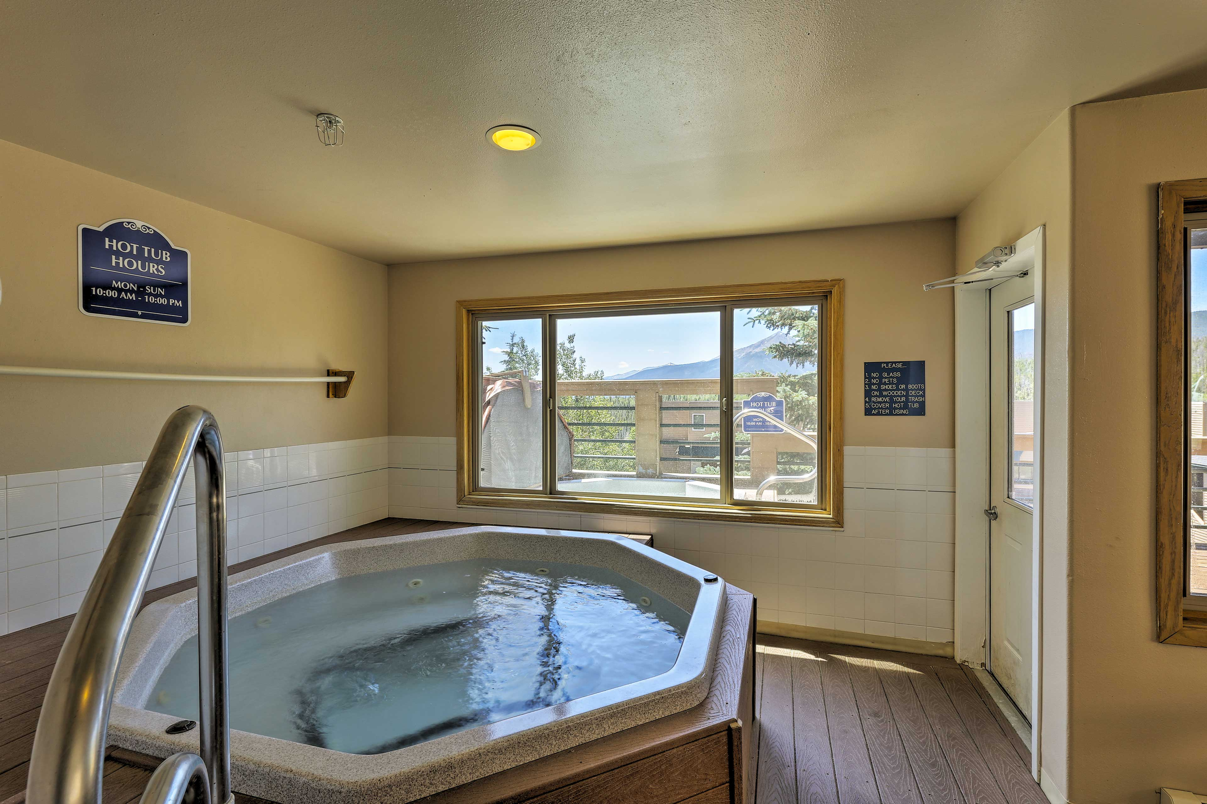 This complex features both an indoor and outdoor hot tub.