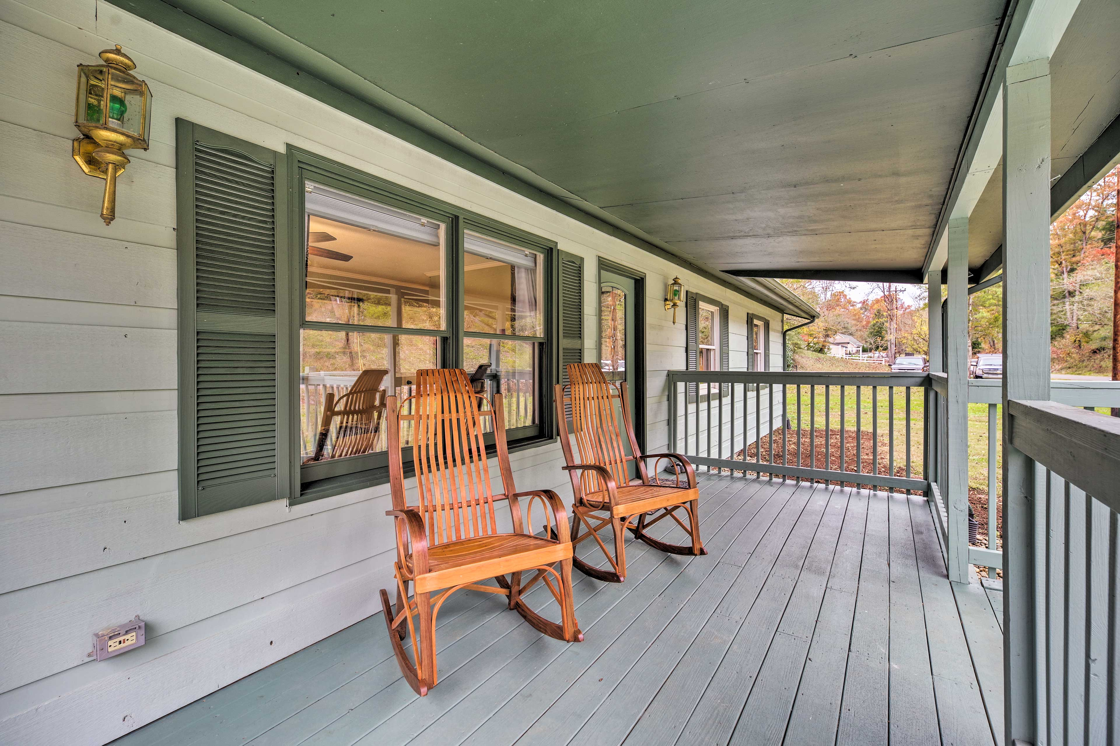 With a large porch and beds for 13, this home is perfect for families.