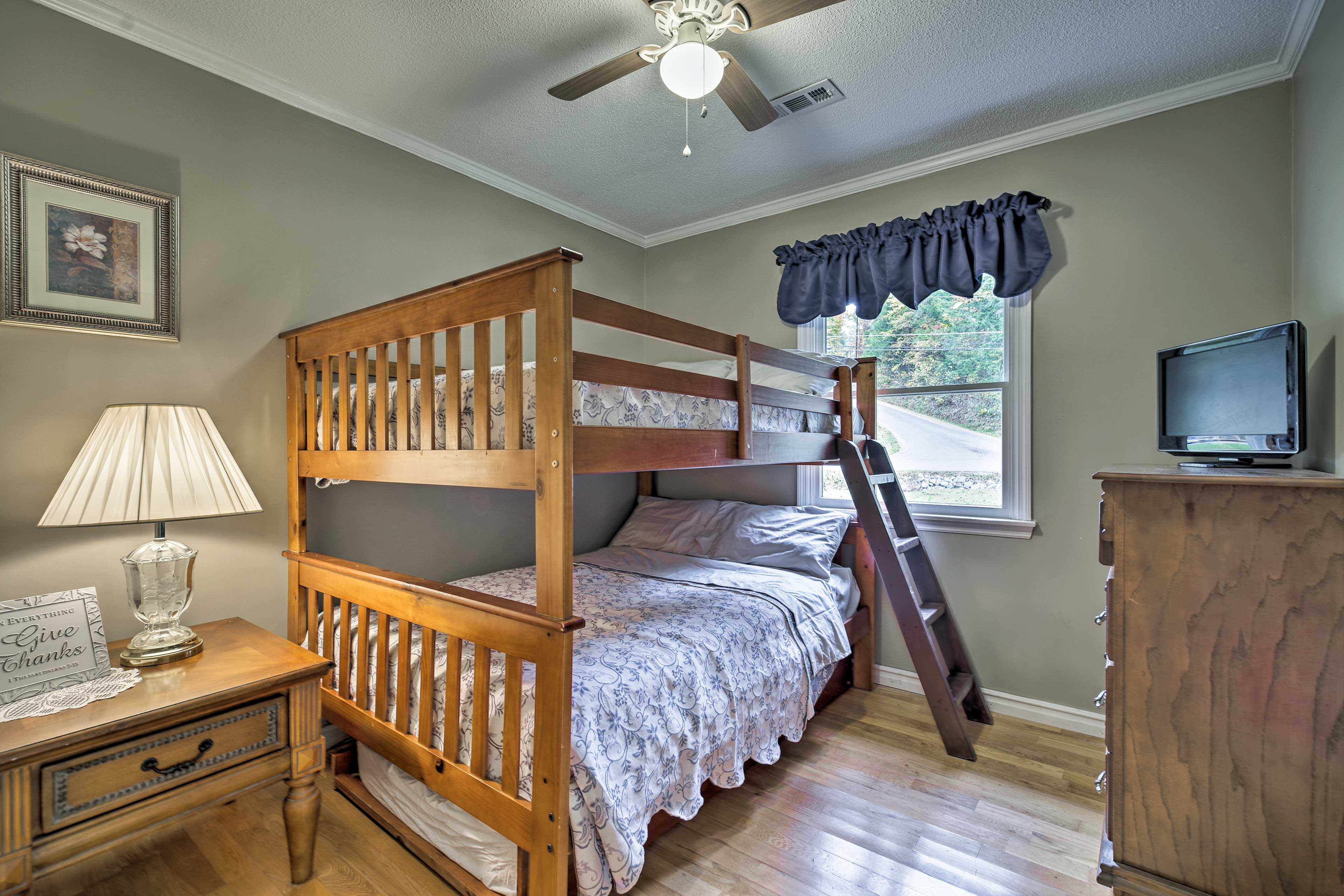 Perfect for kids, this room sleeps 5 in a full-over-full bunk bed with trundle.