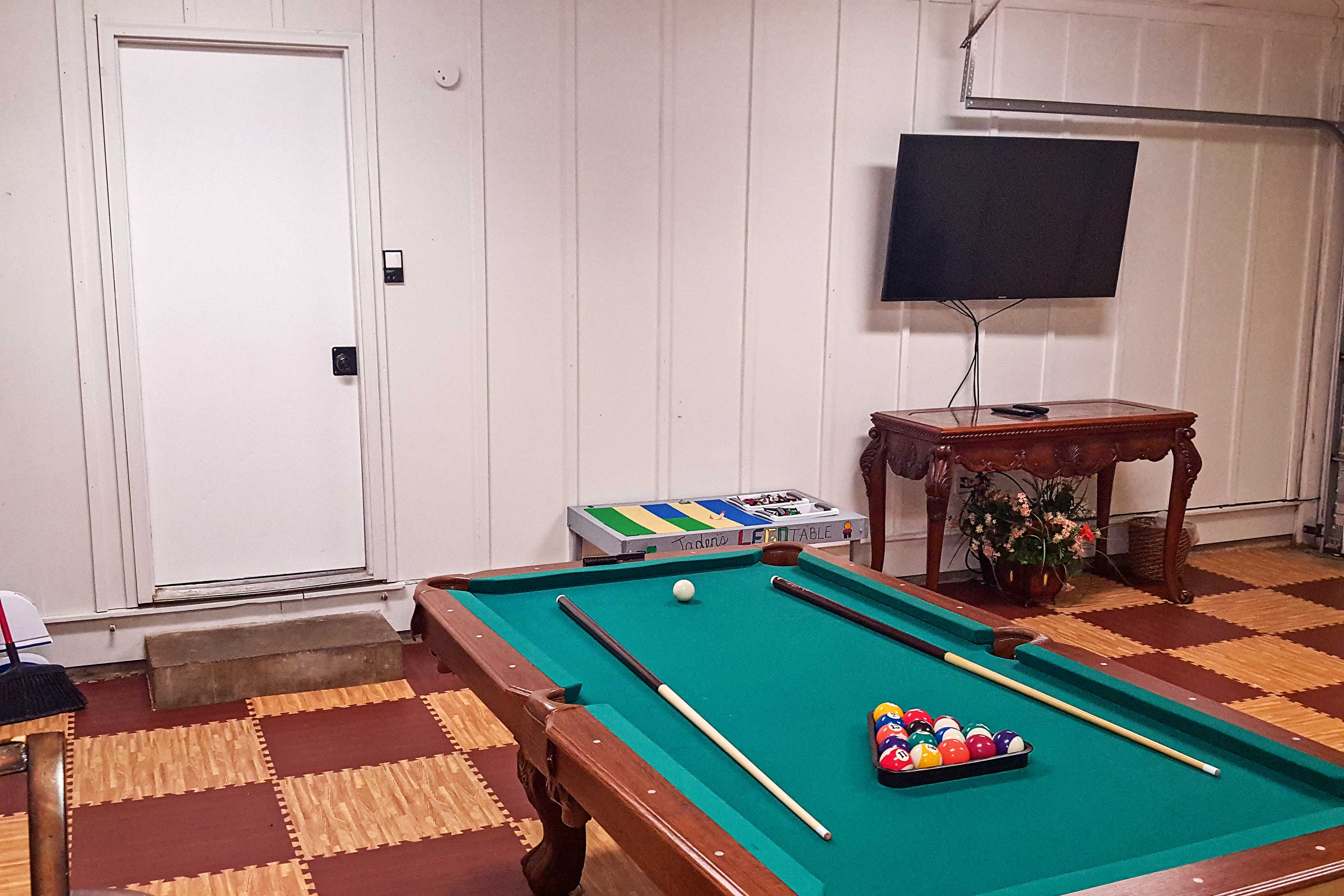 Watch a movie in the game room on the new flat-screen TV!