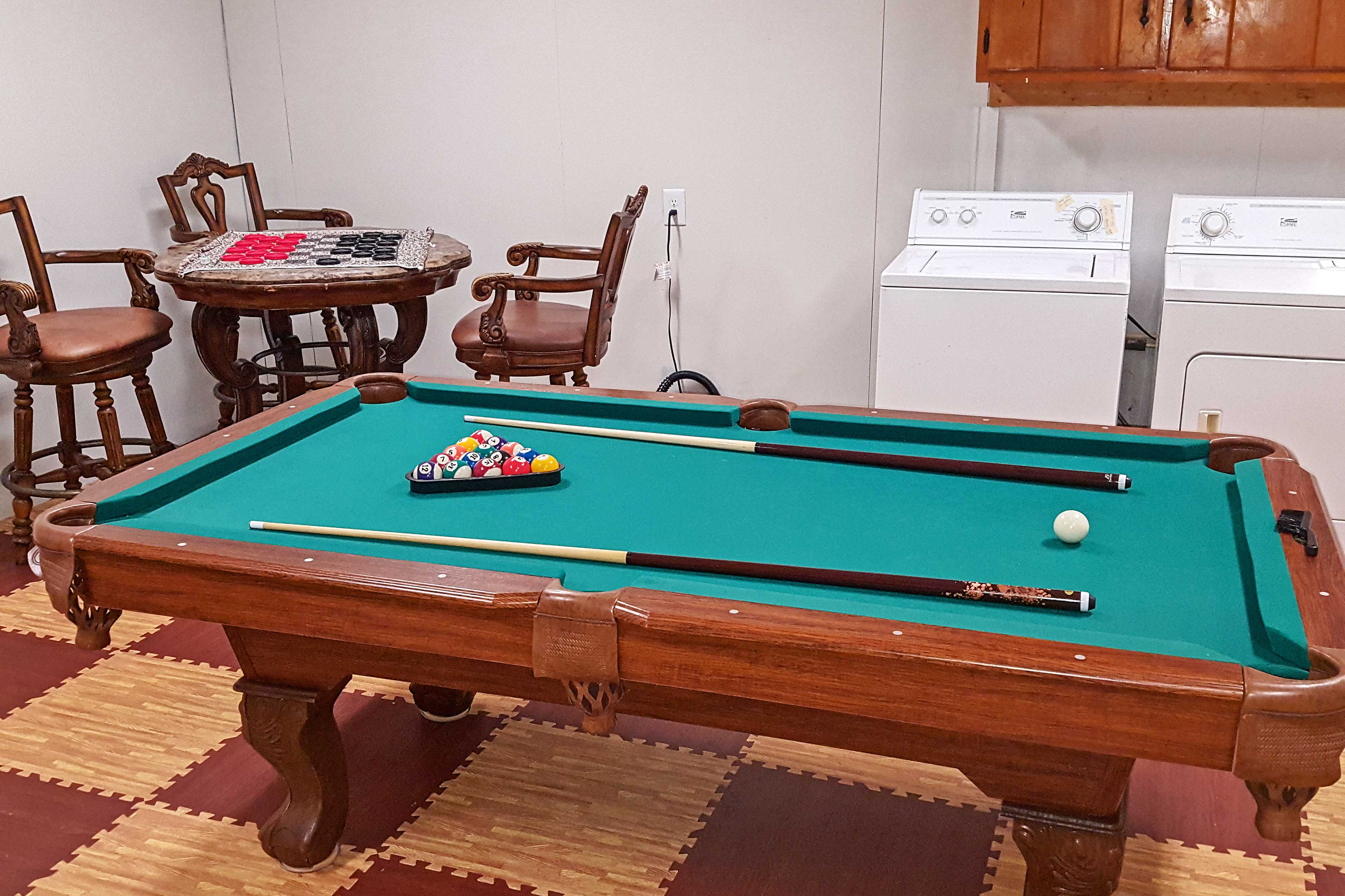 This room also features a card table and pool table! Plus, laundry machines!