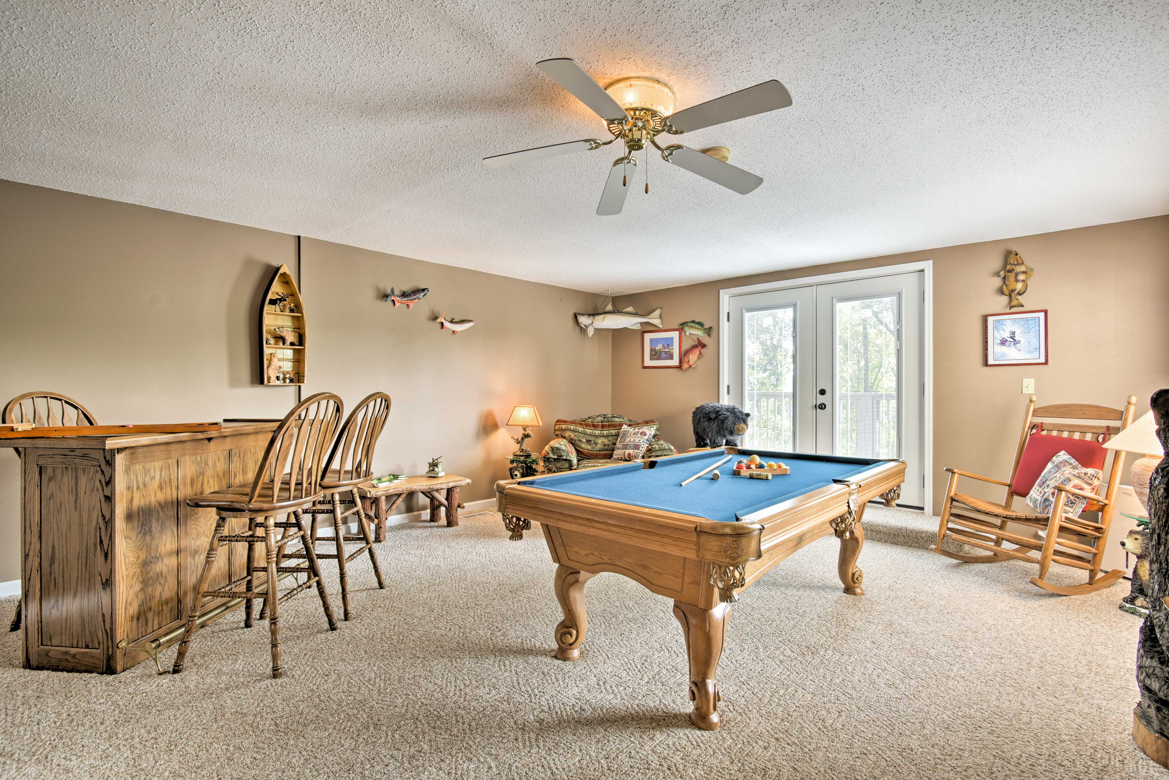 The game room houses a pool table.