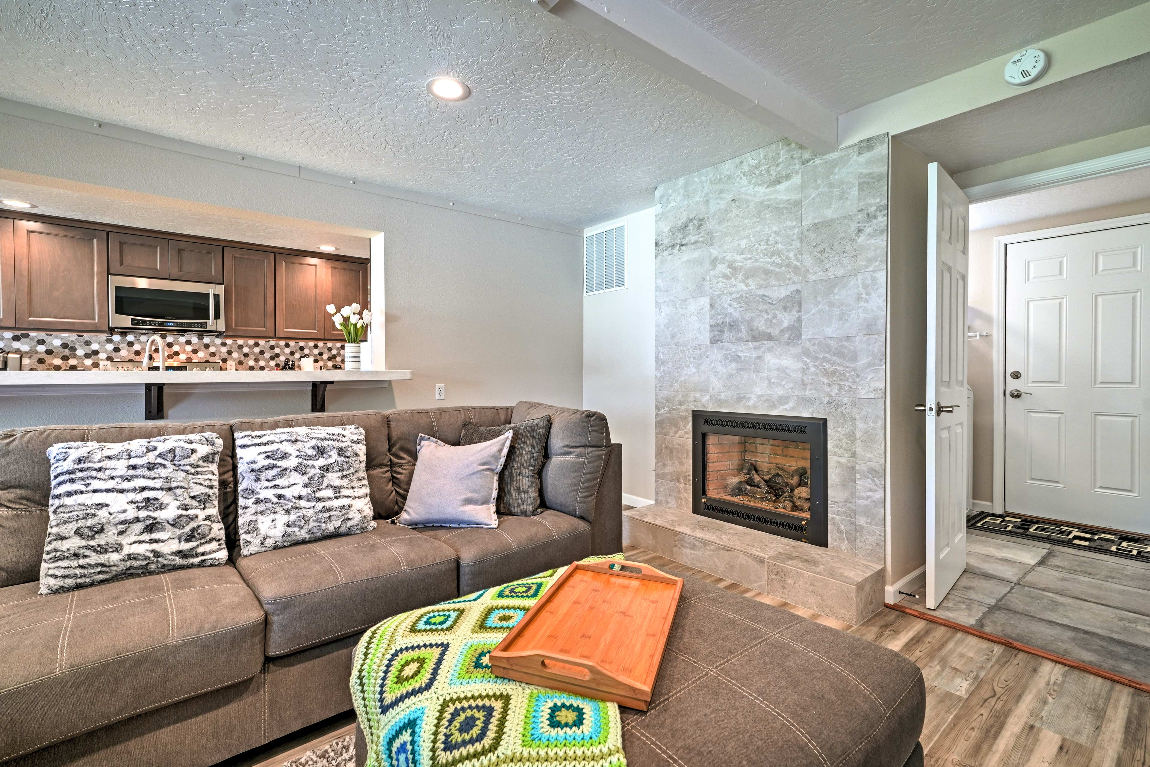 Cozy up by the fireplace on the large sectional.