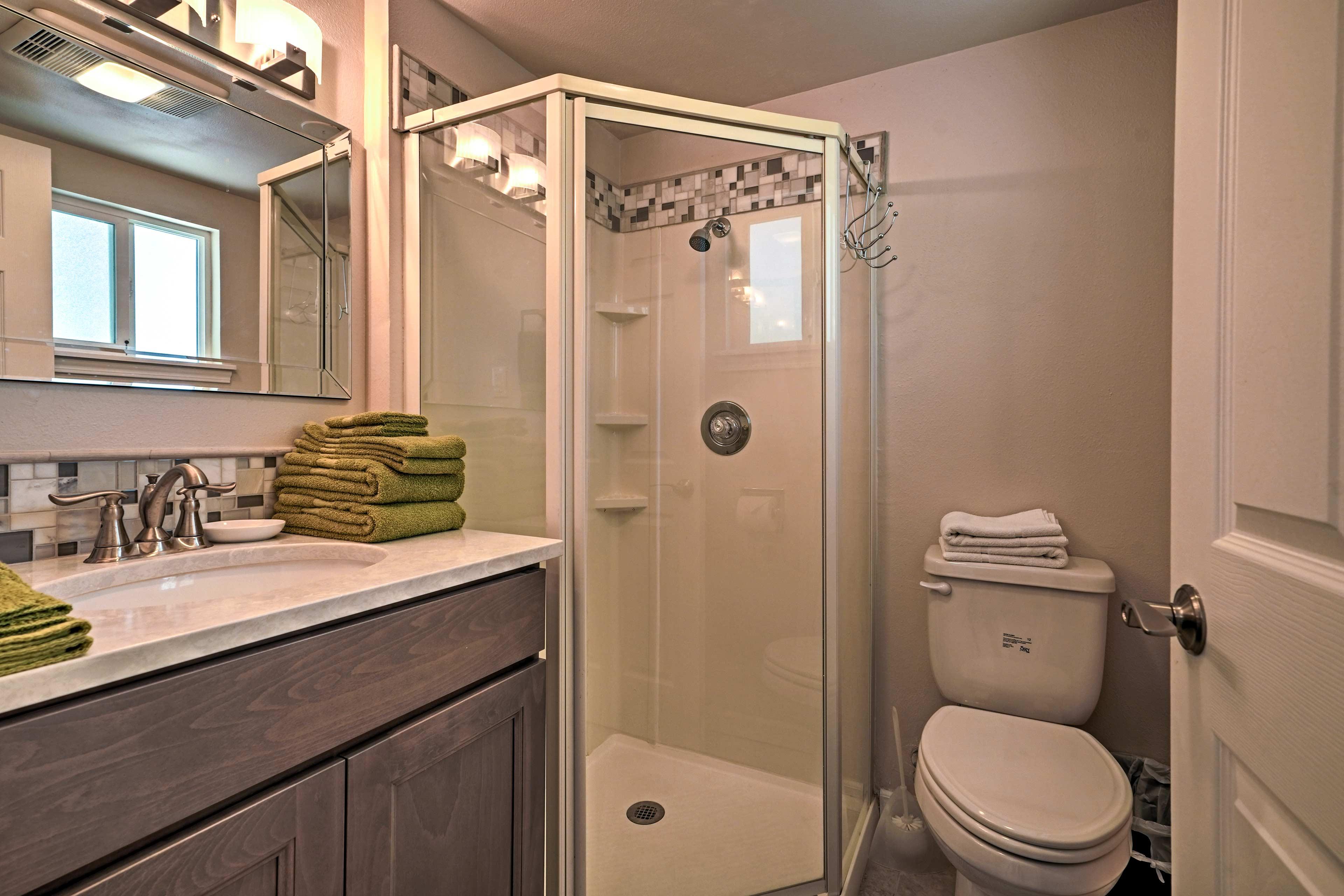 The en-suite bathroom boasts a walk-in shower.