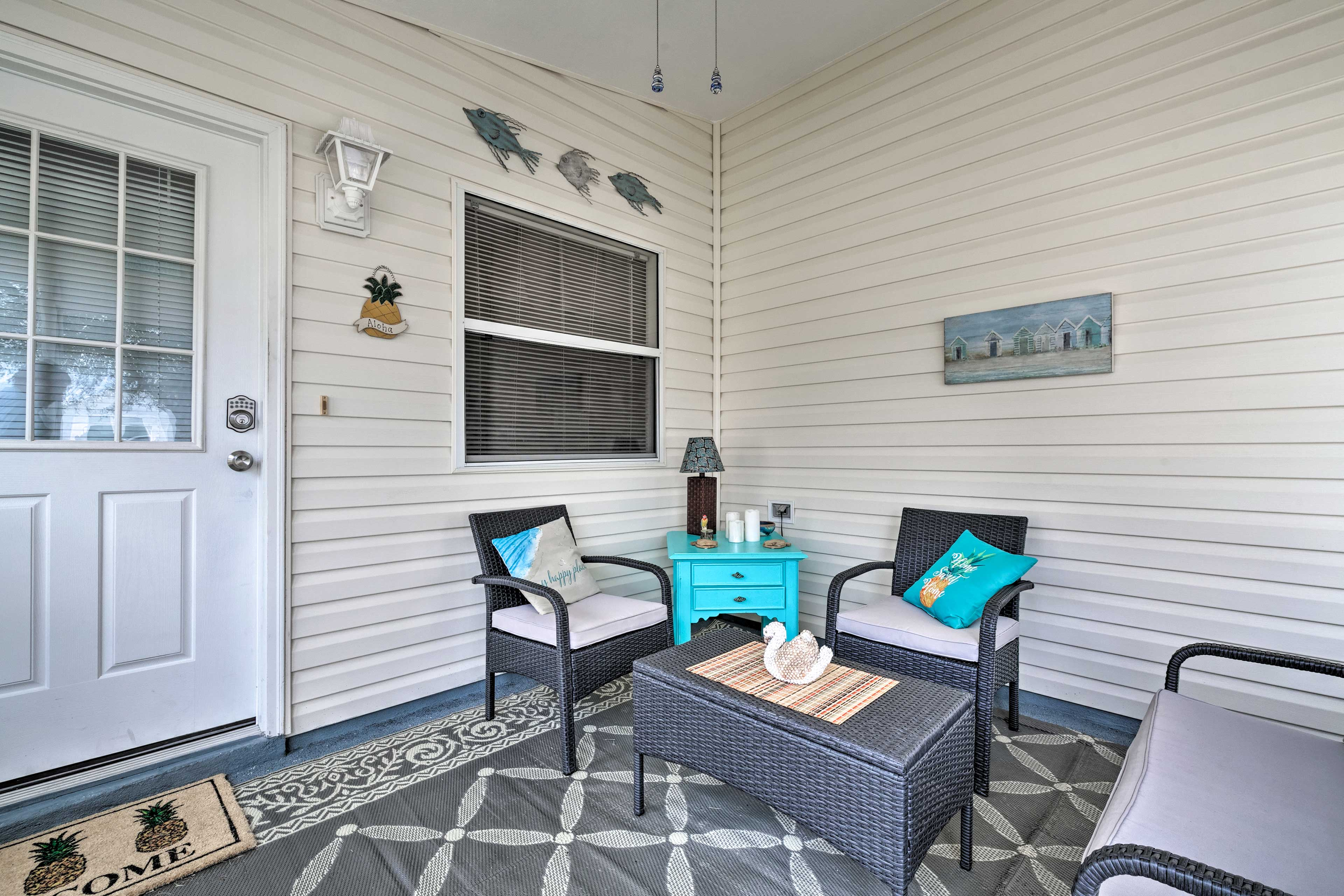 Enjoy a glass of wine and great conversation on your private screened-in lanai.