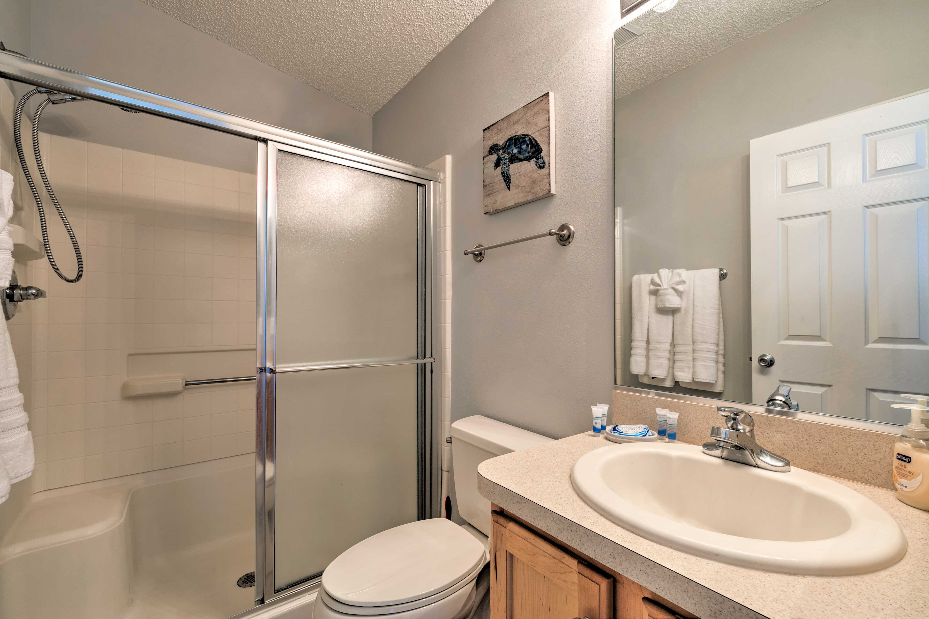 Get ready for the day in the en-suite bath.