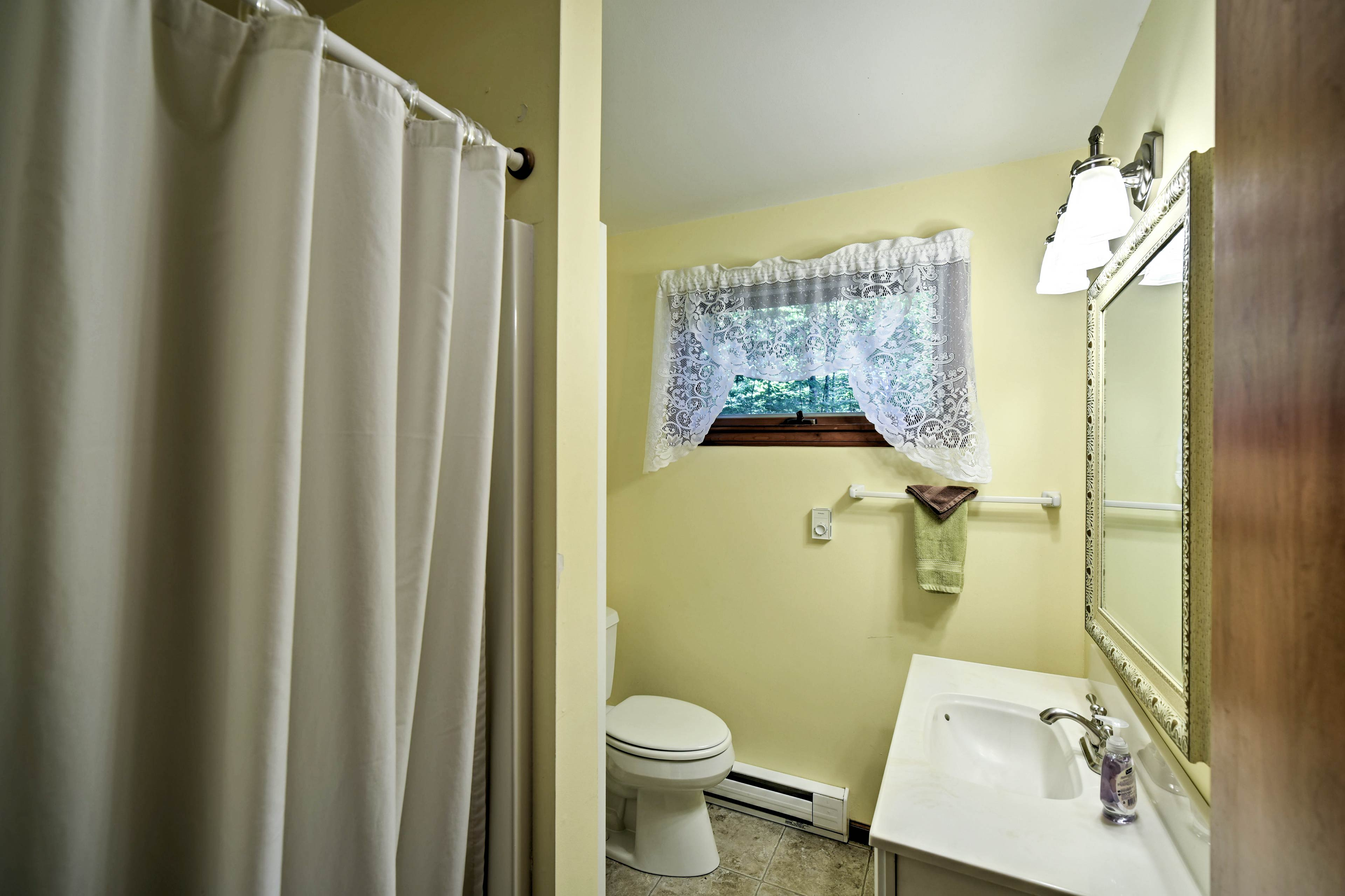 A shower/tub combo completes the full bathroom.