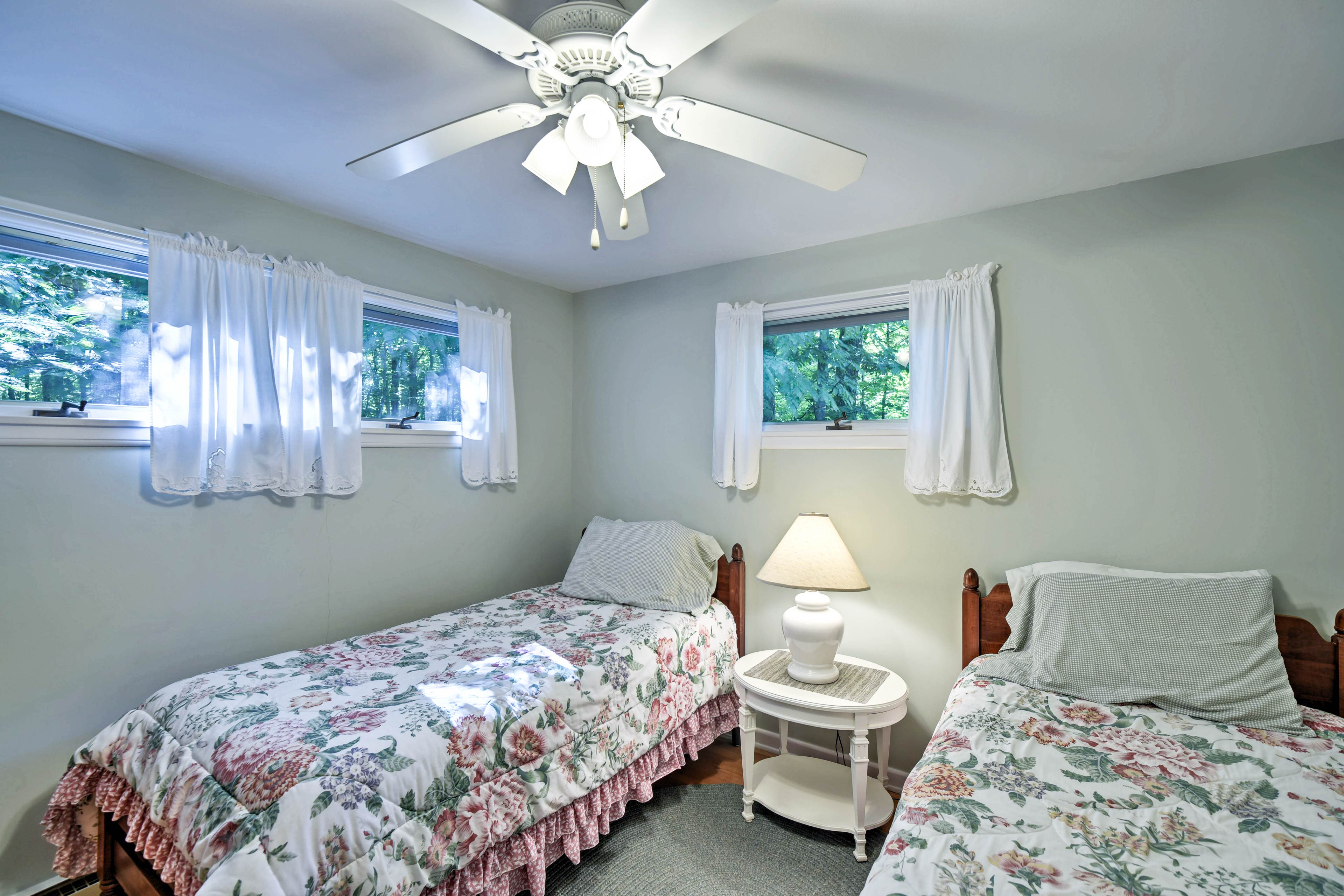 Two twin beds are provided in the second bedroom.
