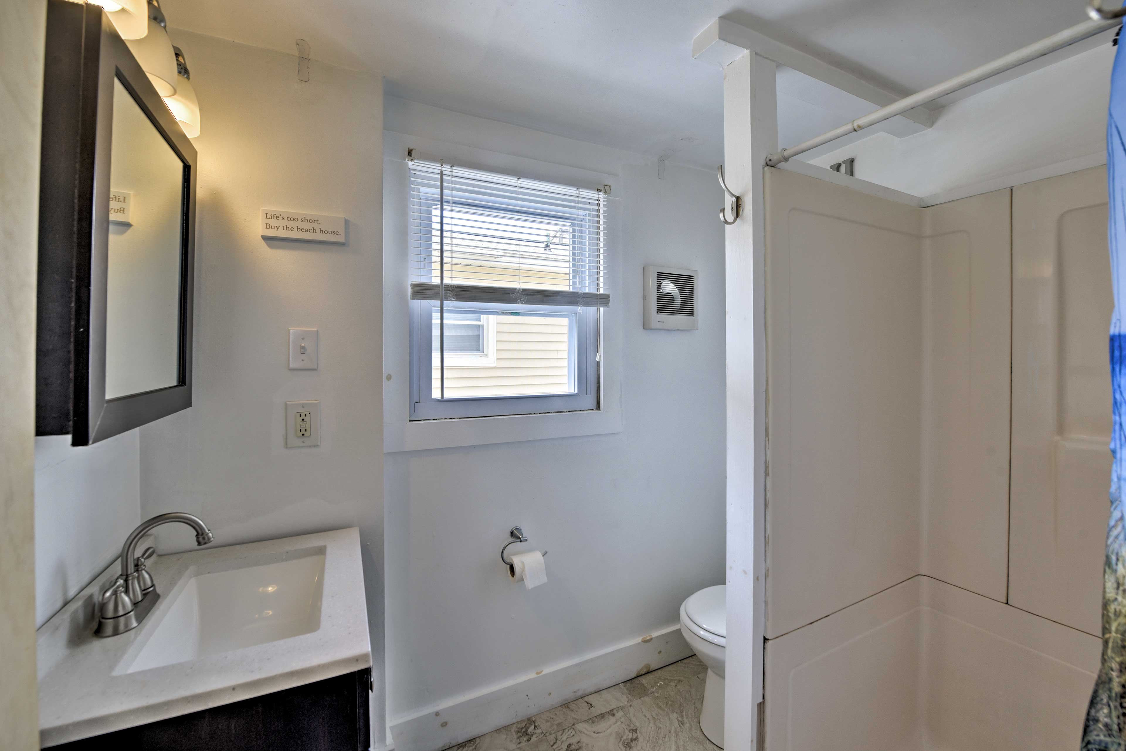 Take a rinse in the walk-in shower after a day at the beach!