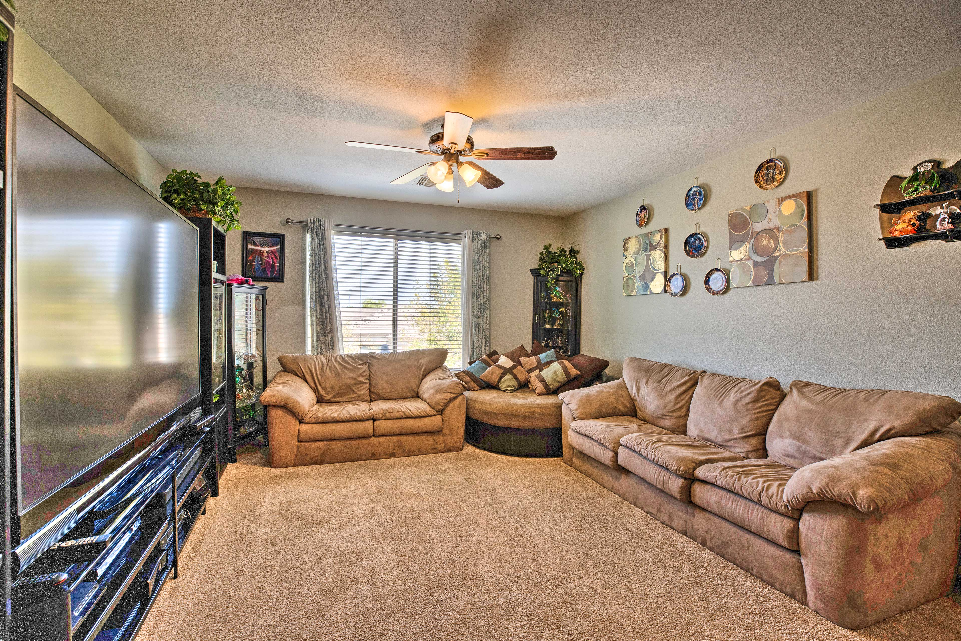 Plush couches and soft carpeting complement this room nicely!