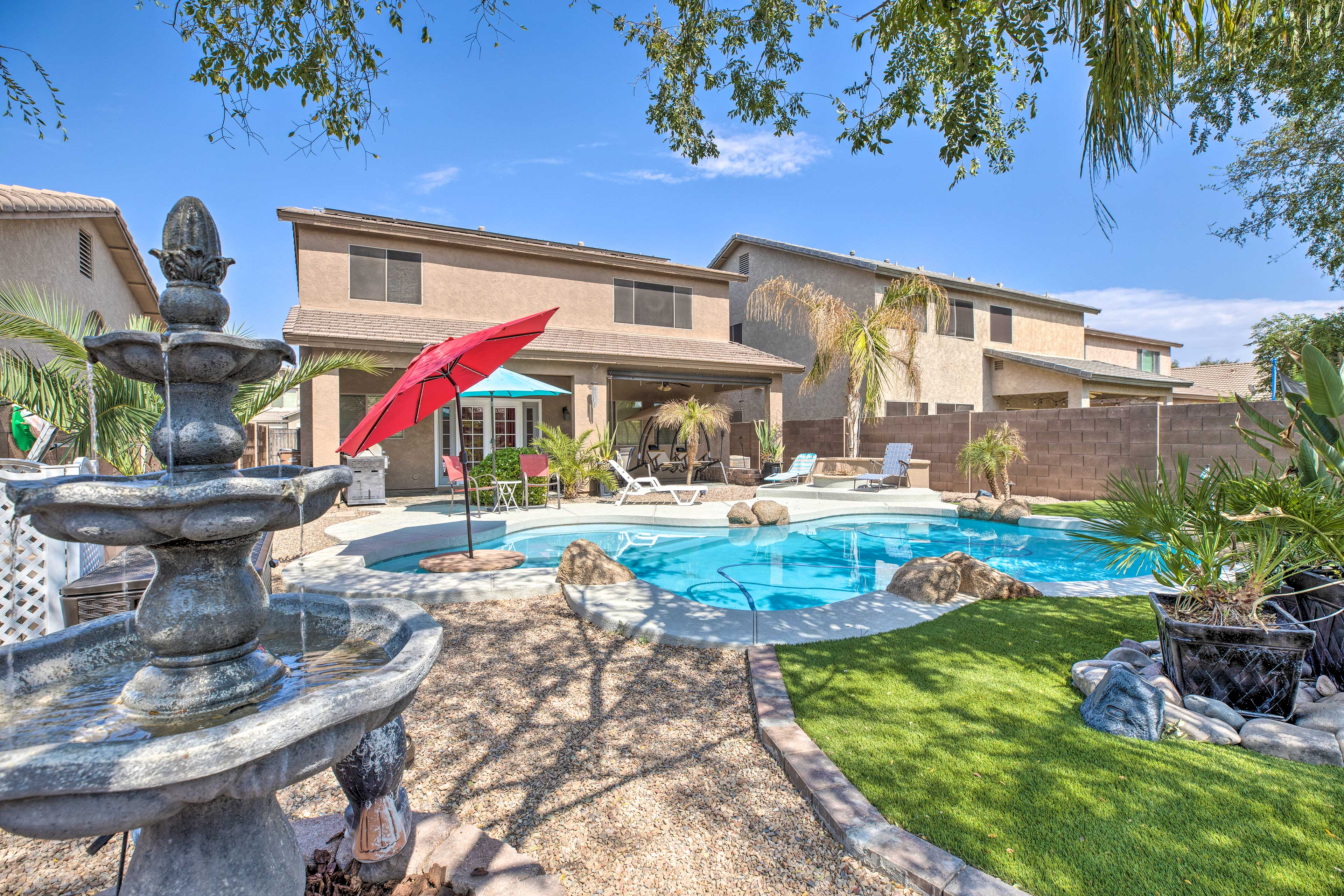 Experience the private backyard with a putting green and full pool!