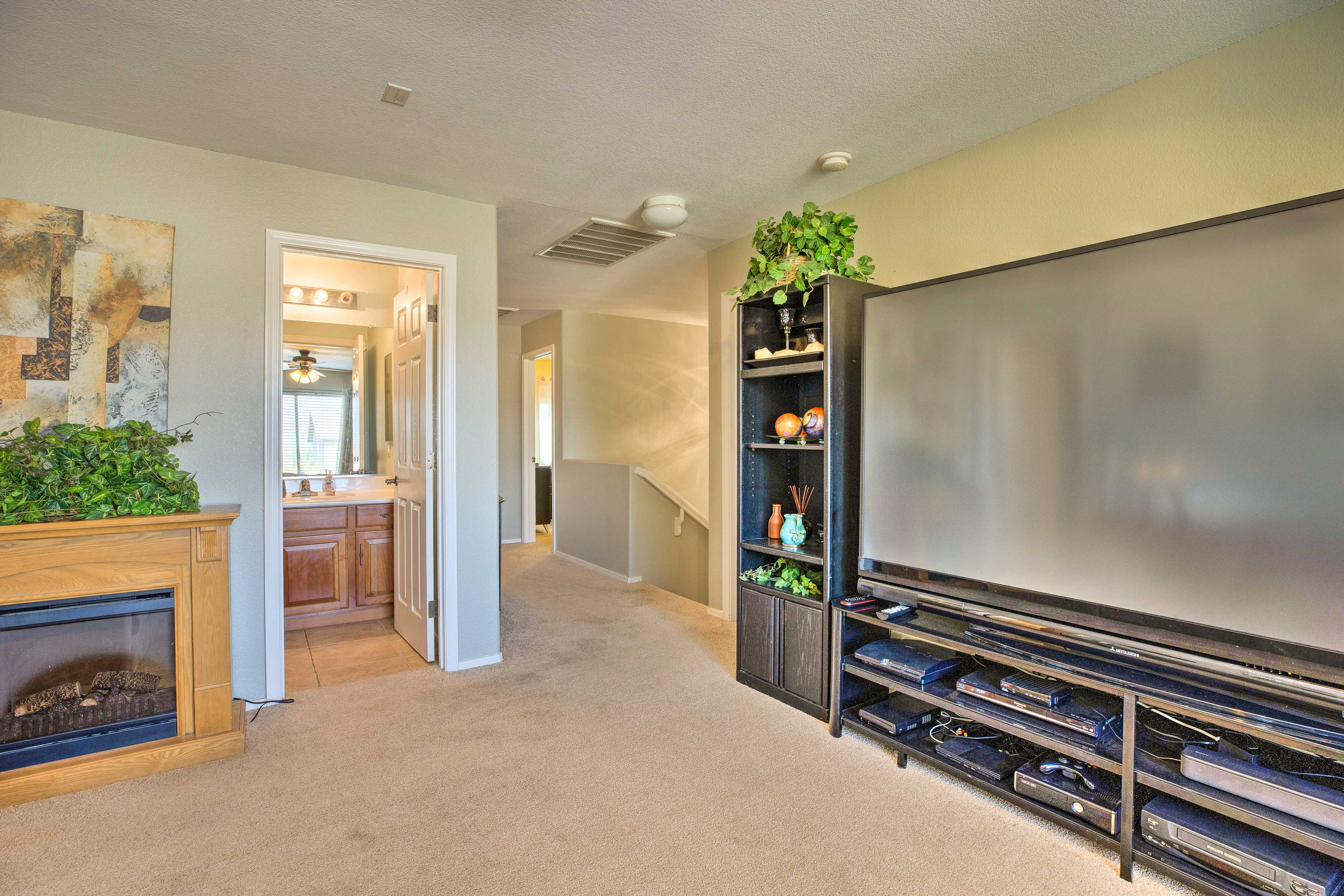 The den features a large flat-screen satellite TV!