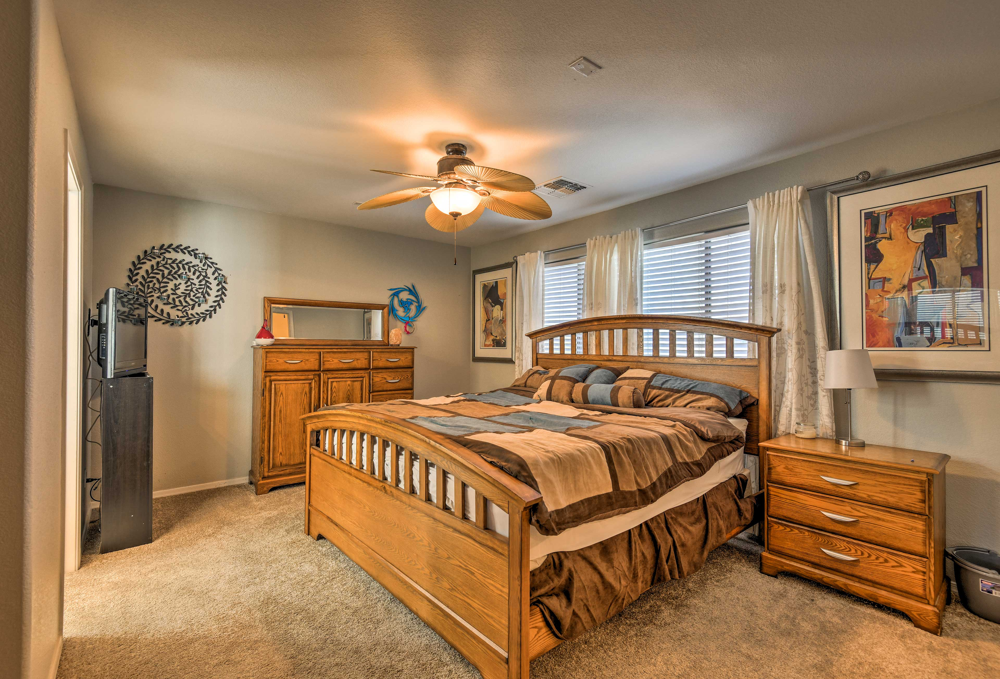 The master bedroom features a lustrous king!