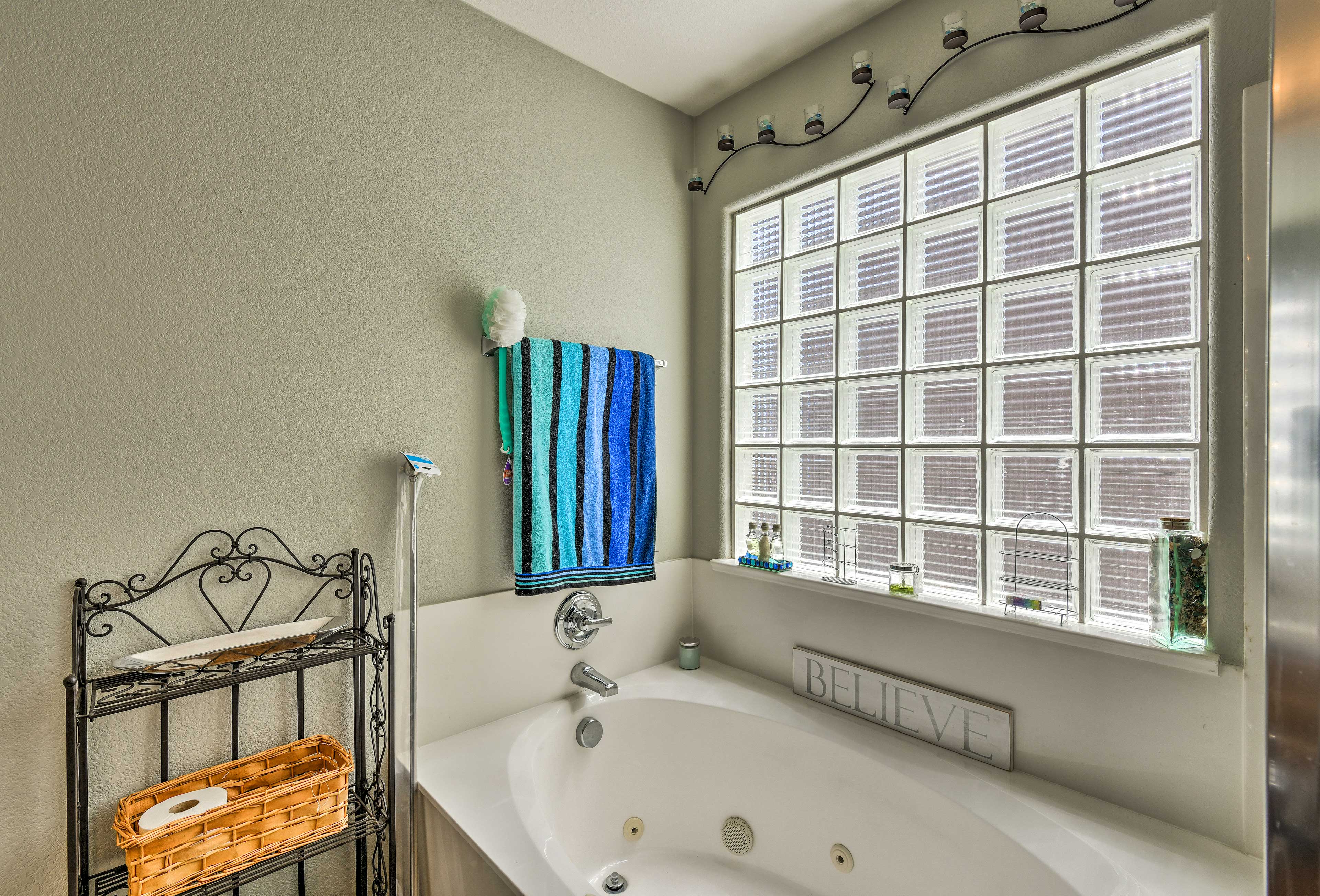 Rinse off in your private Jacuzzi before climbing under the covers!