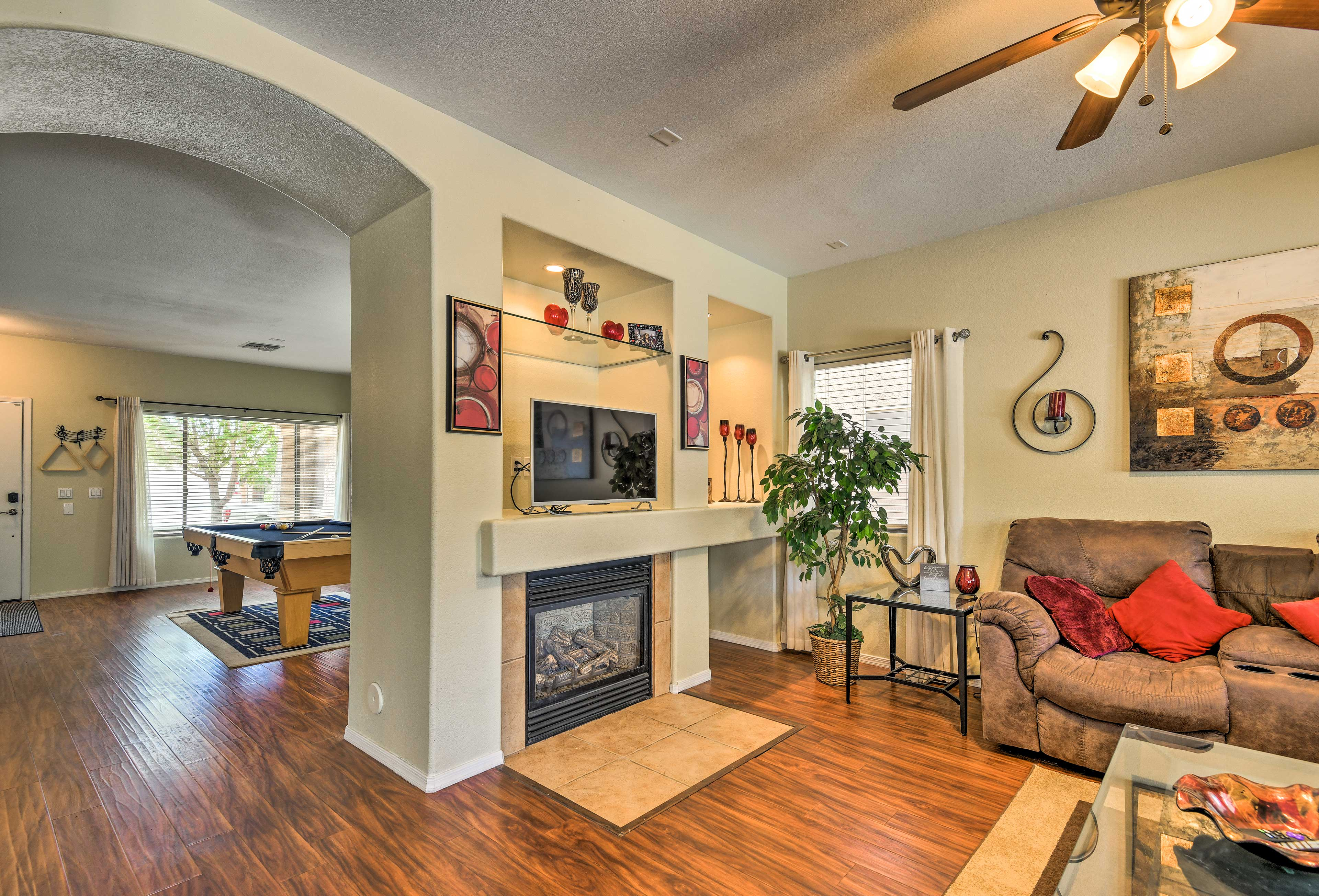 Watch a movie on the flat-screen satellite TV atop the gas fireplace!