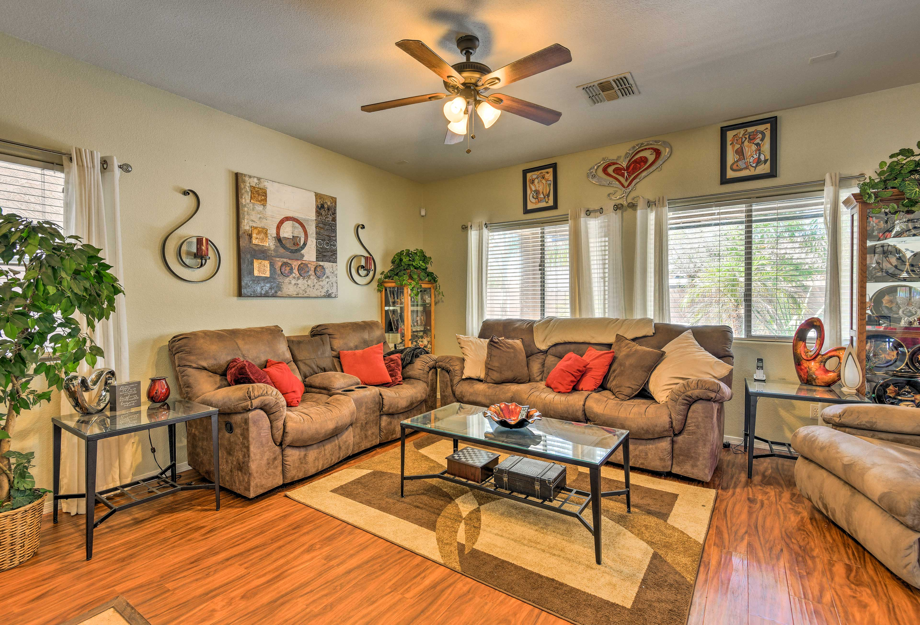 Gather as a group in the lavish living space complete with cozy couches!
