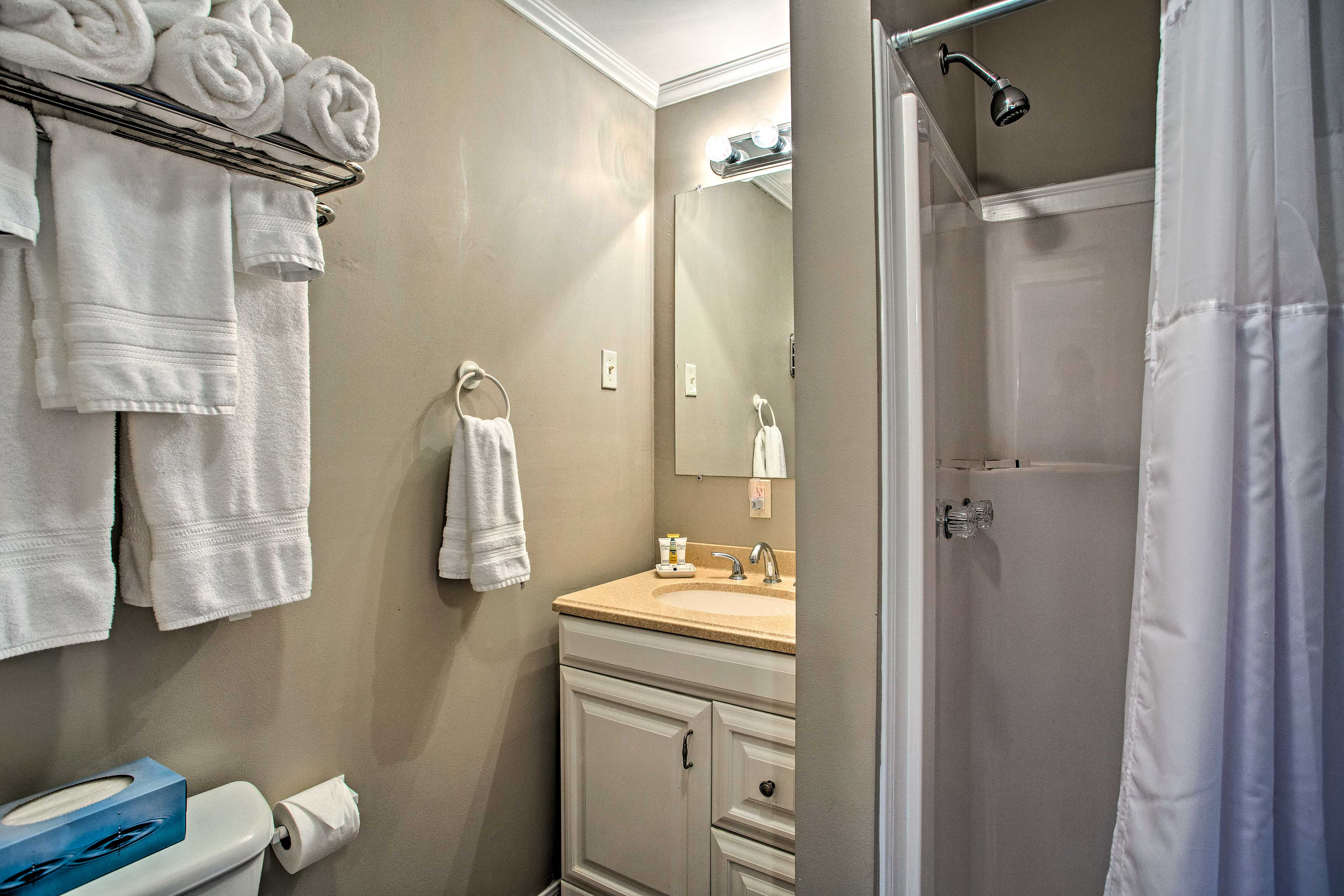 The bathroom is equipped with plenty of towels for your stay.
