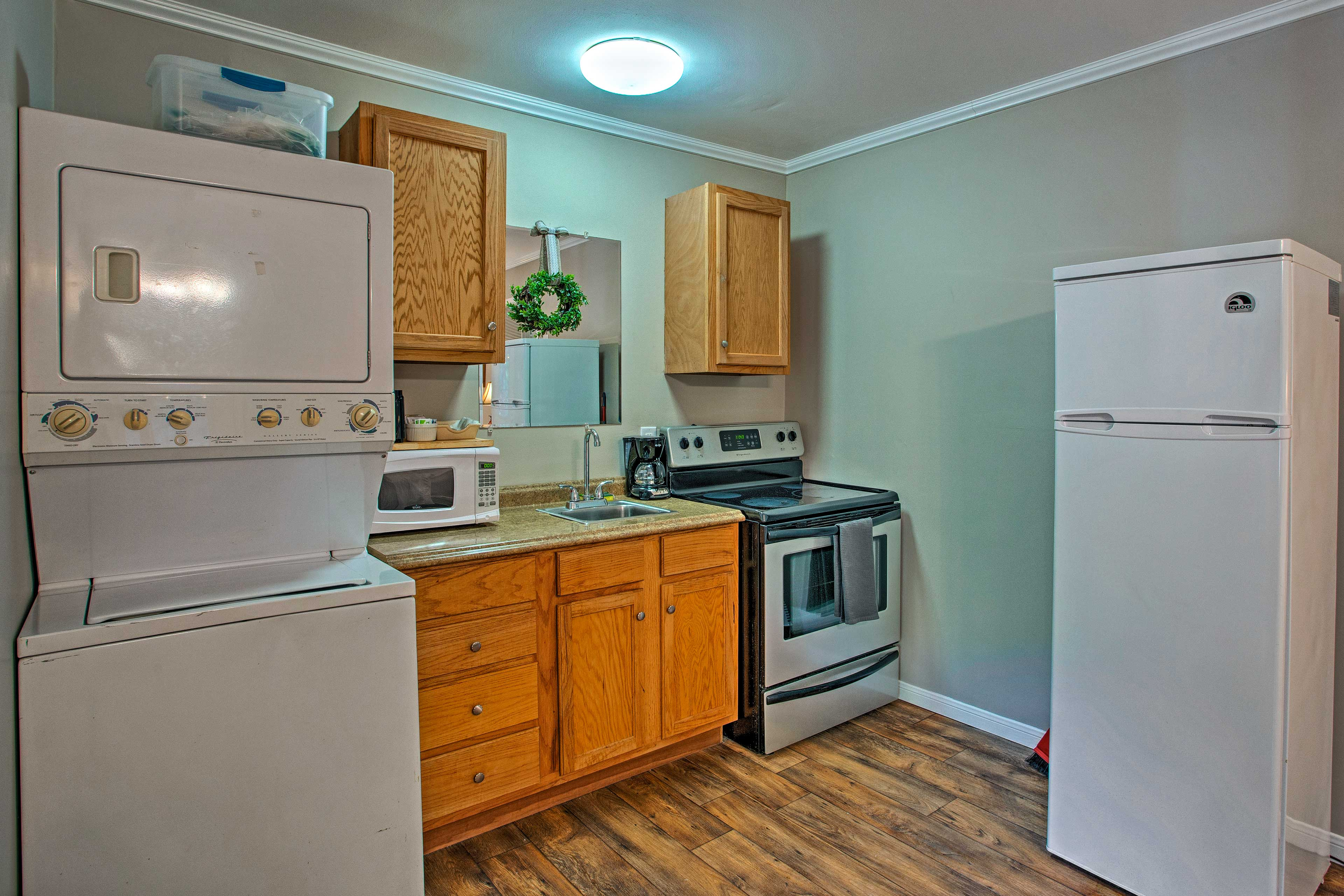 The cabin features a well-equipped kitchen as well as laundry machines.