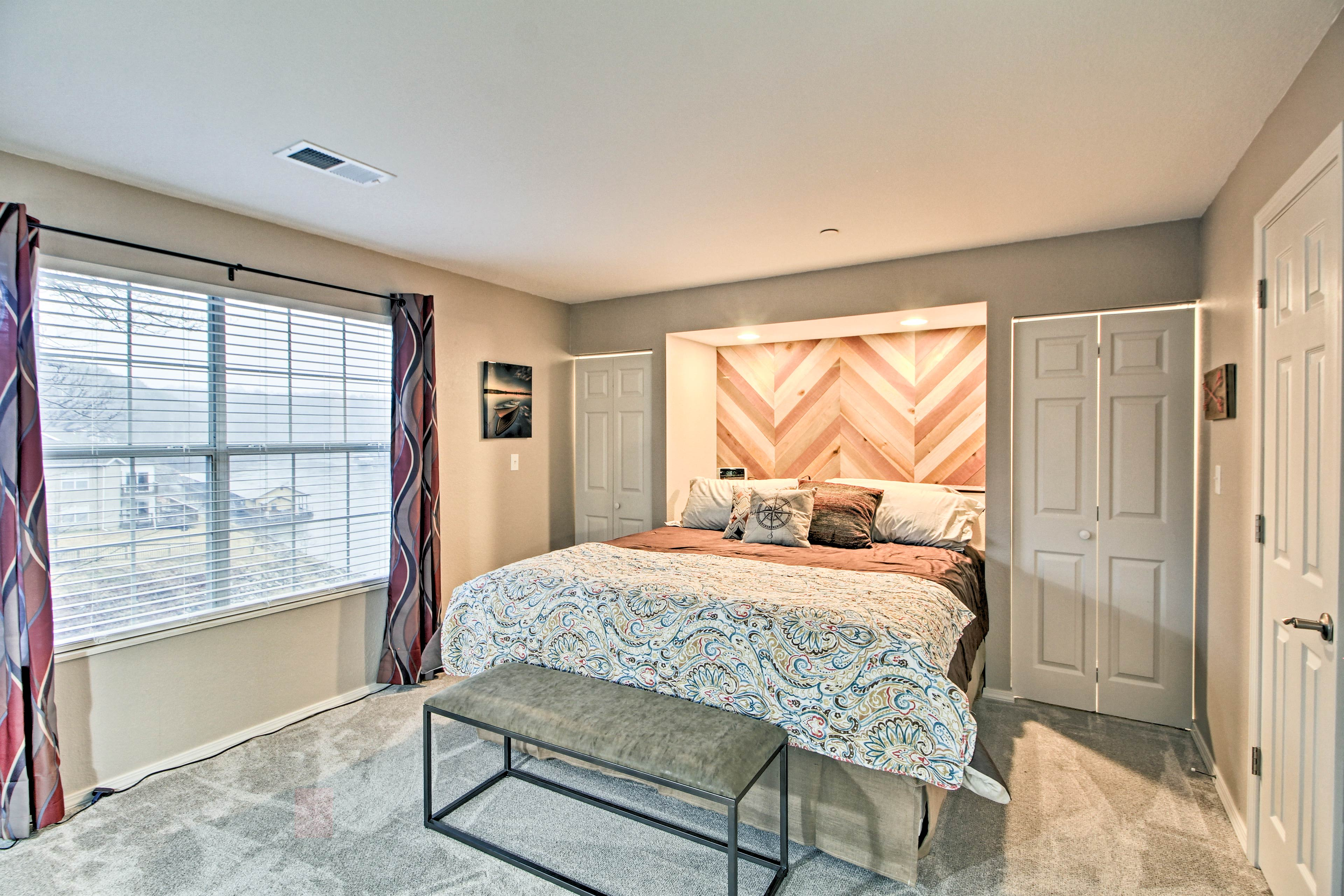 Heads of the household can claim this lovely master bedroom for themselves.