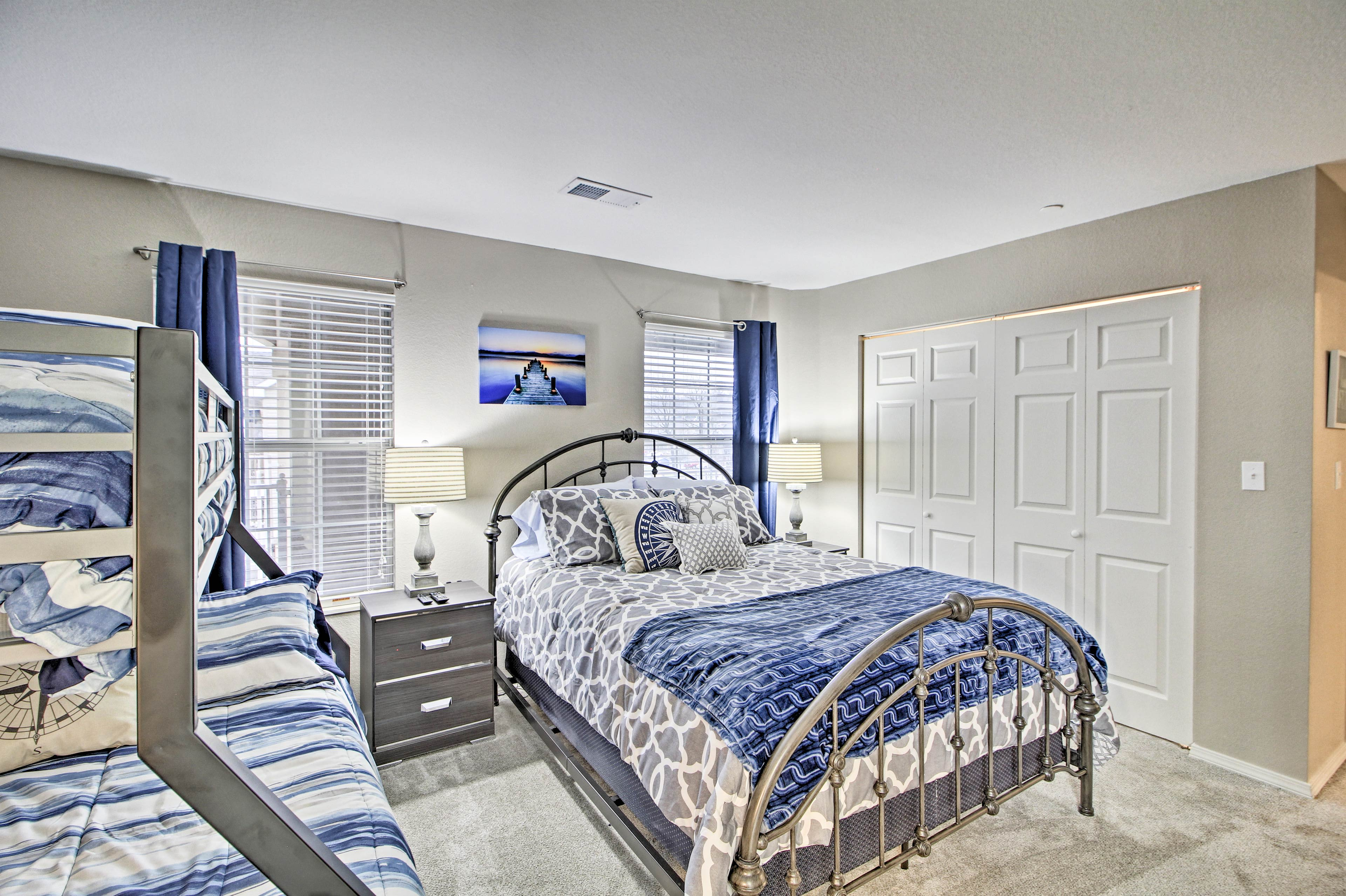 The second bedroom features a twin-over full bunk bed & queen bed.