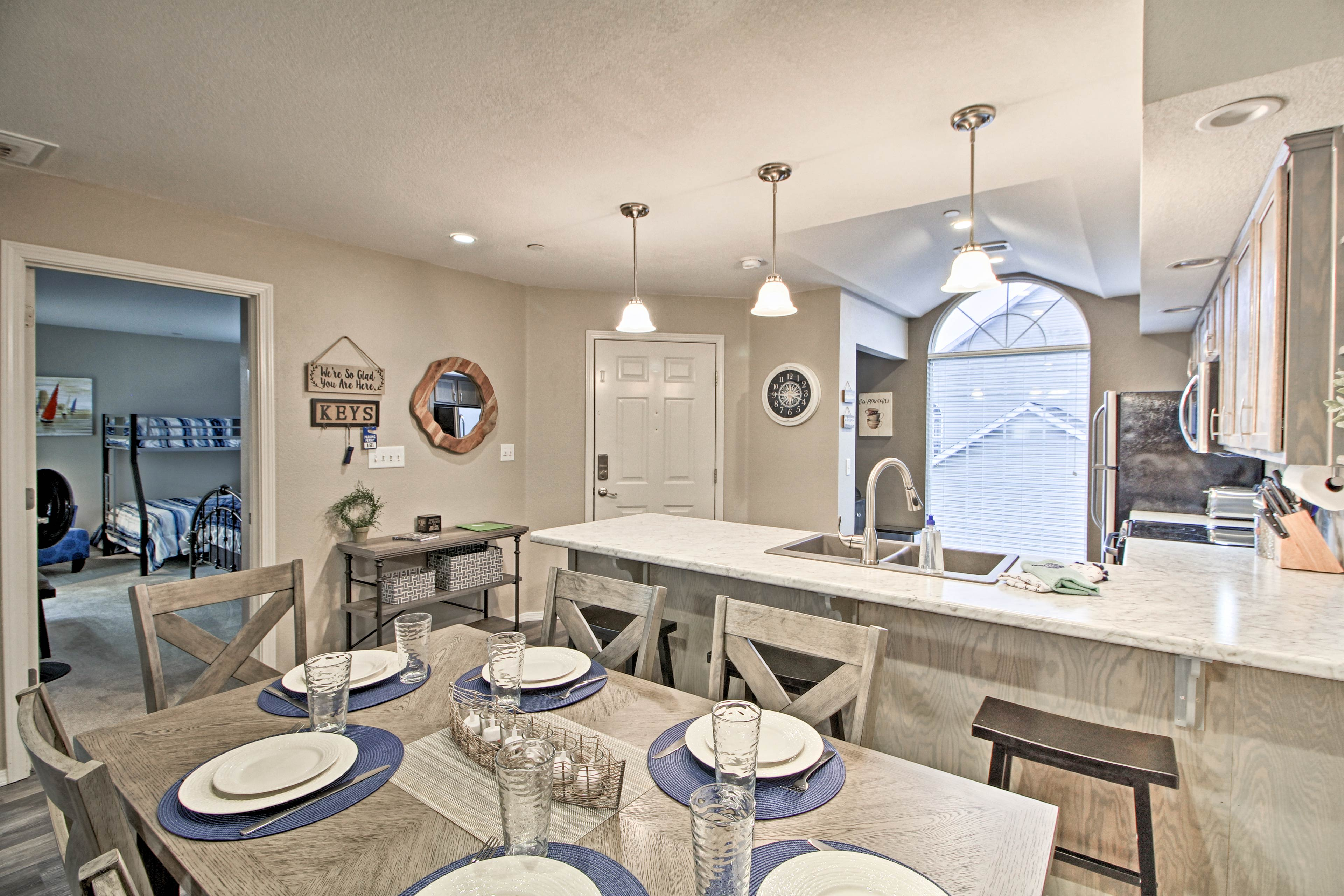 Gather around the 6-person dining table for home-cooked meals.