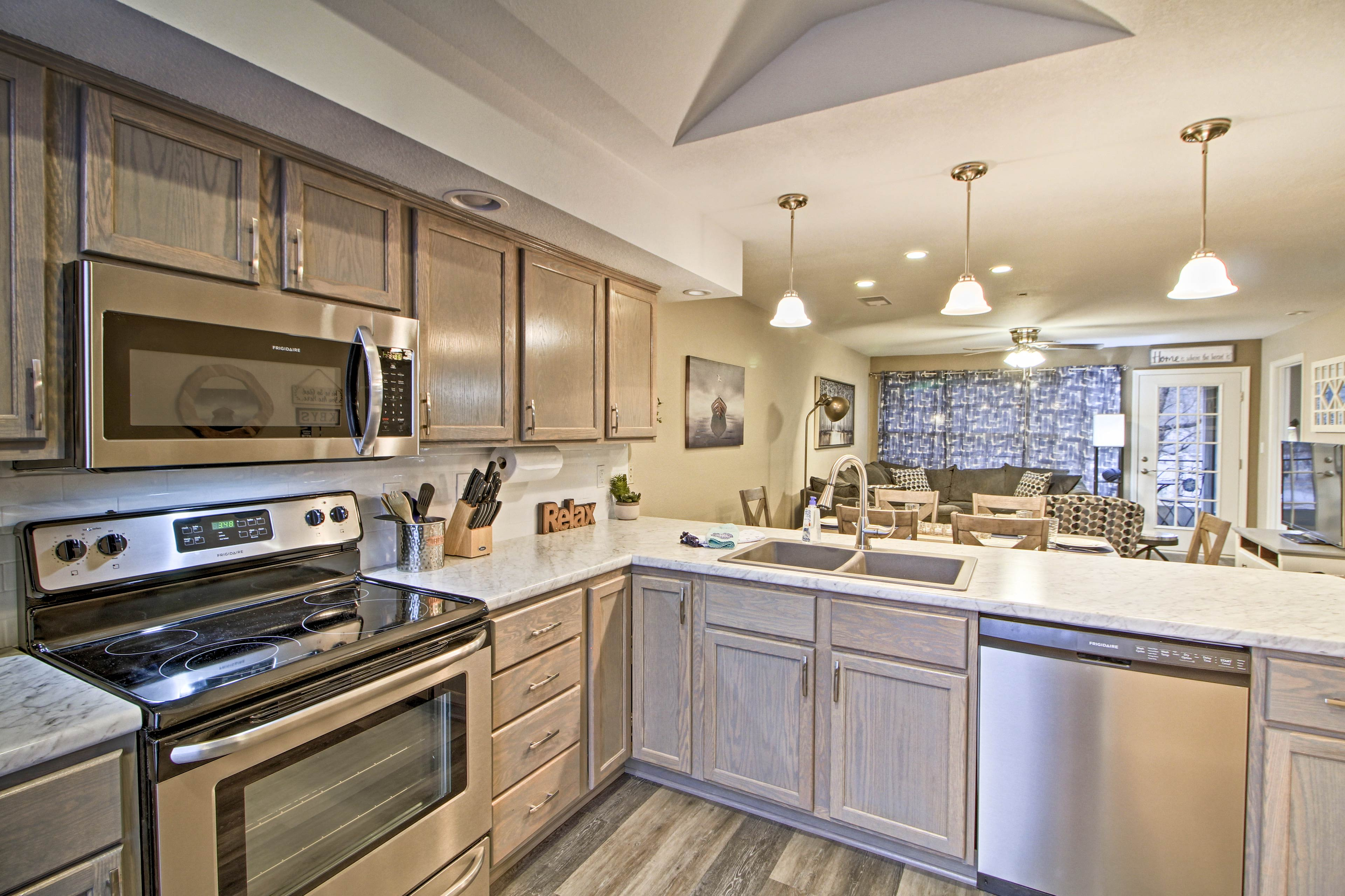 Stainless steel appliances elevate the fully equipped kitchen.