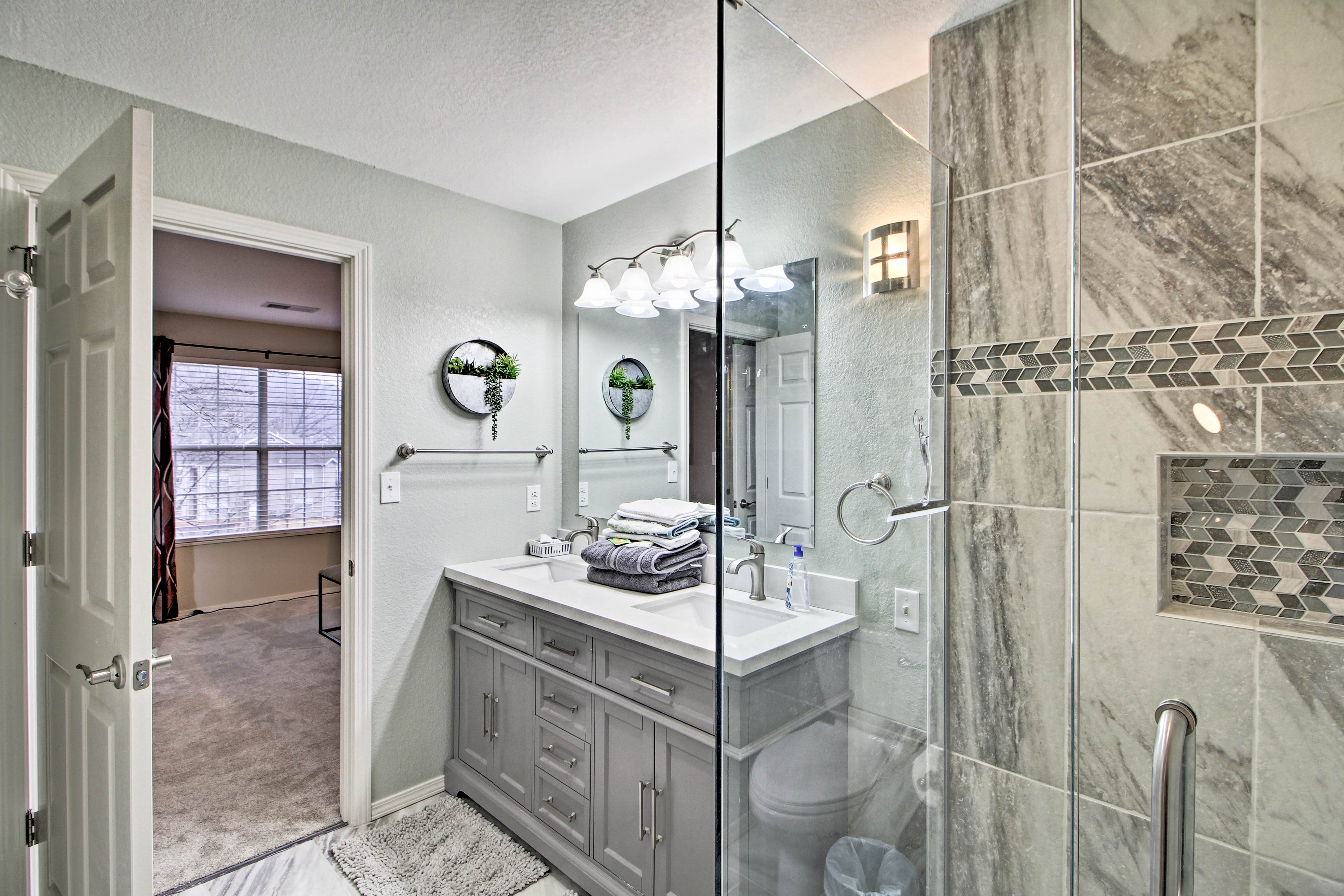 The master bathroom includes a walk-in shower & double vanity.