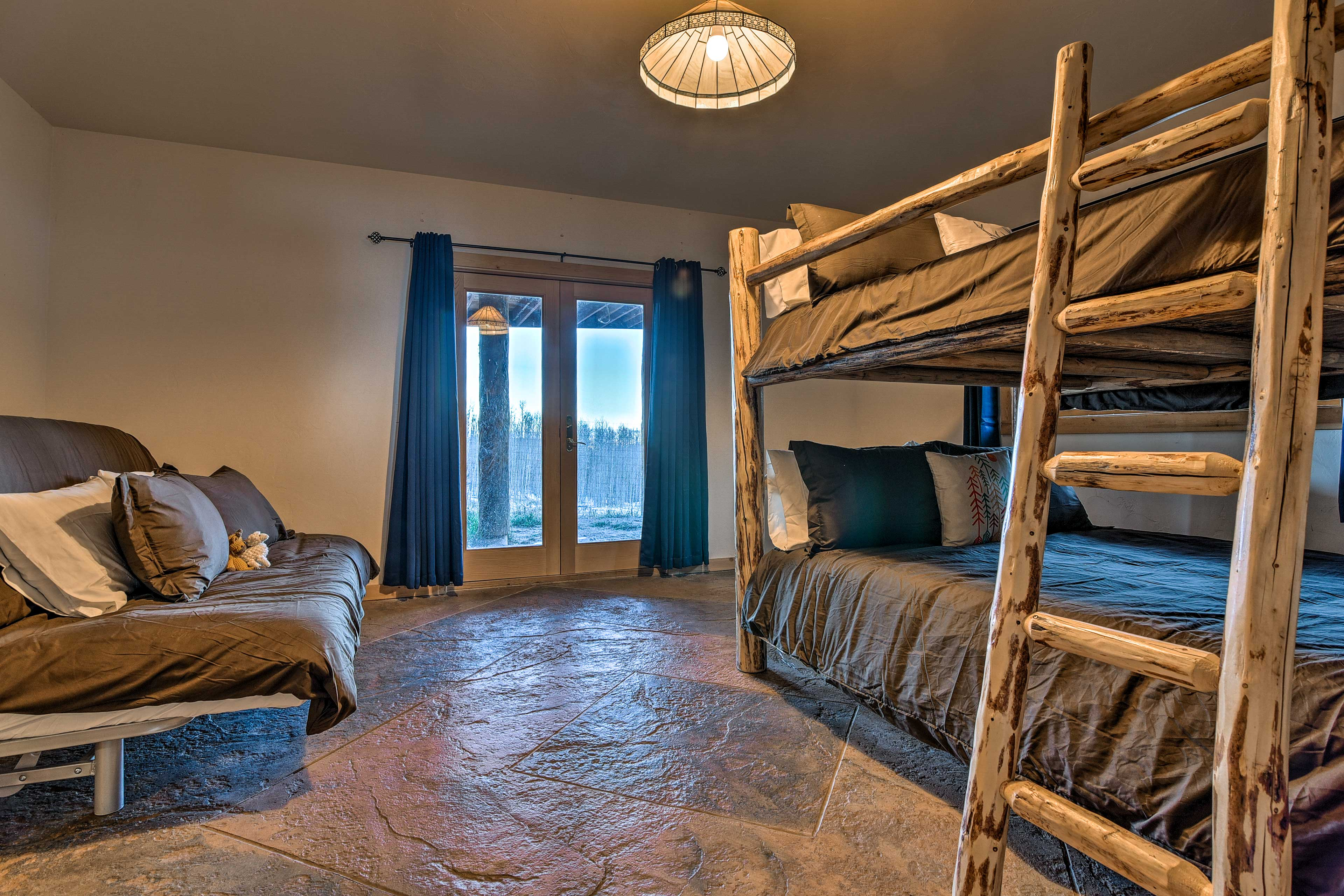 The final bedroom boasts a queen-over-queen bunk and futon.