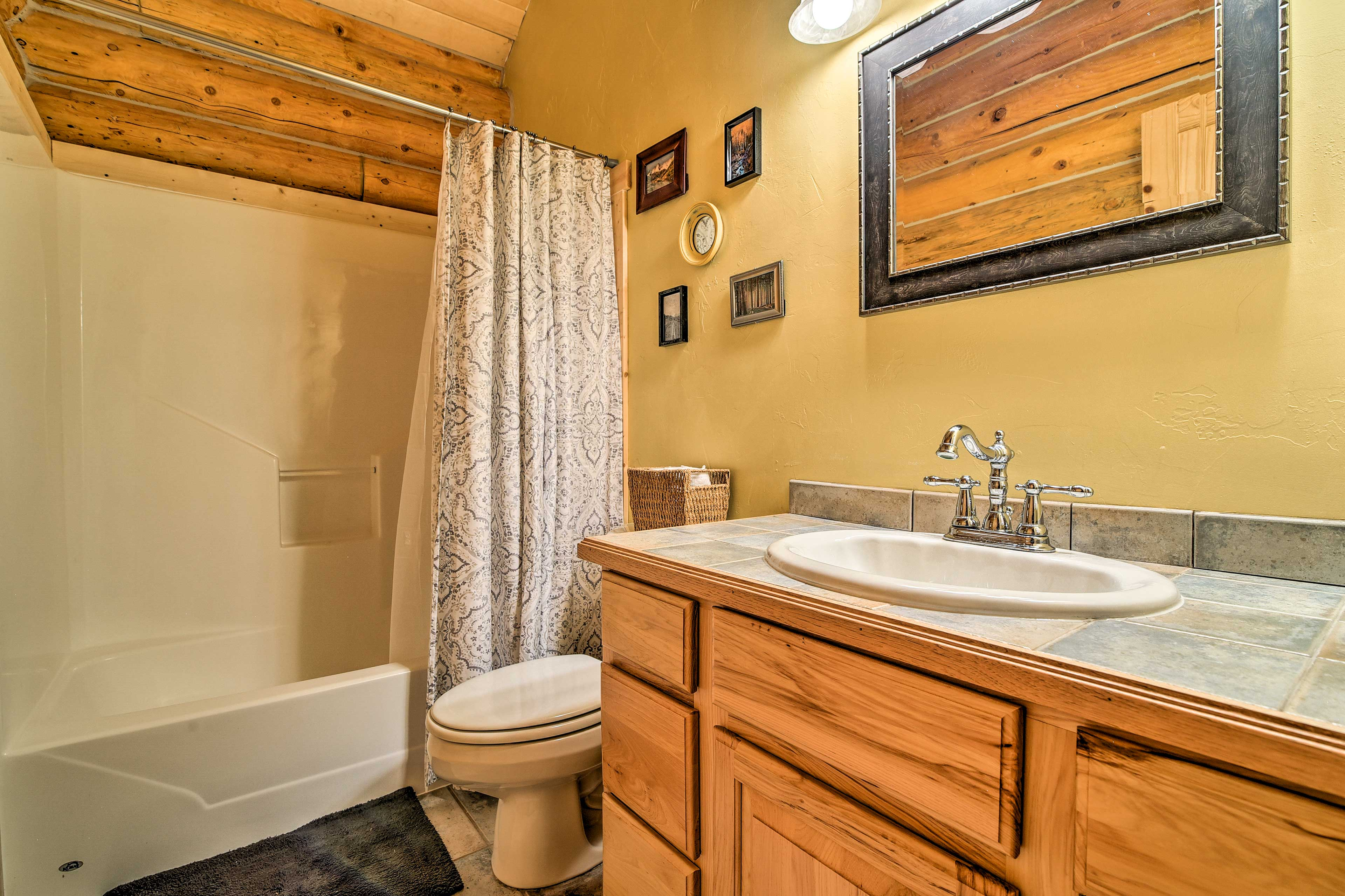 The next bathroom is a full with a shower/tub combo.