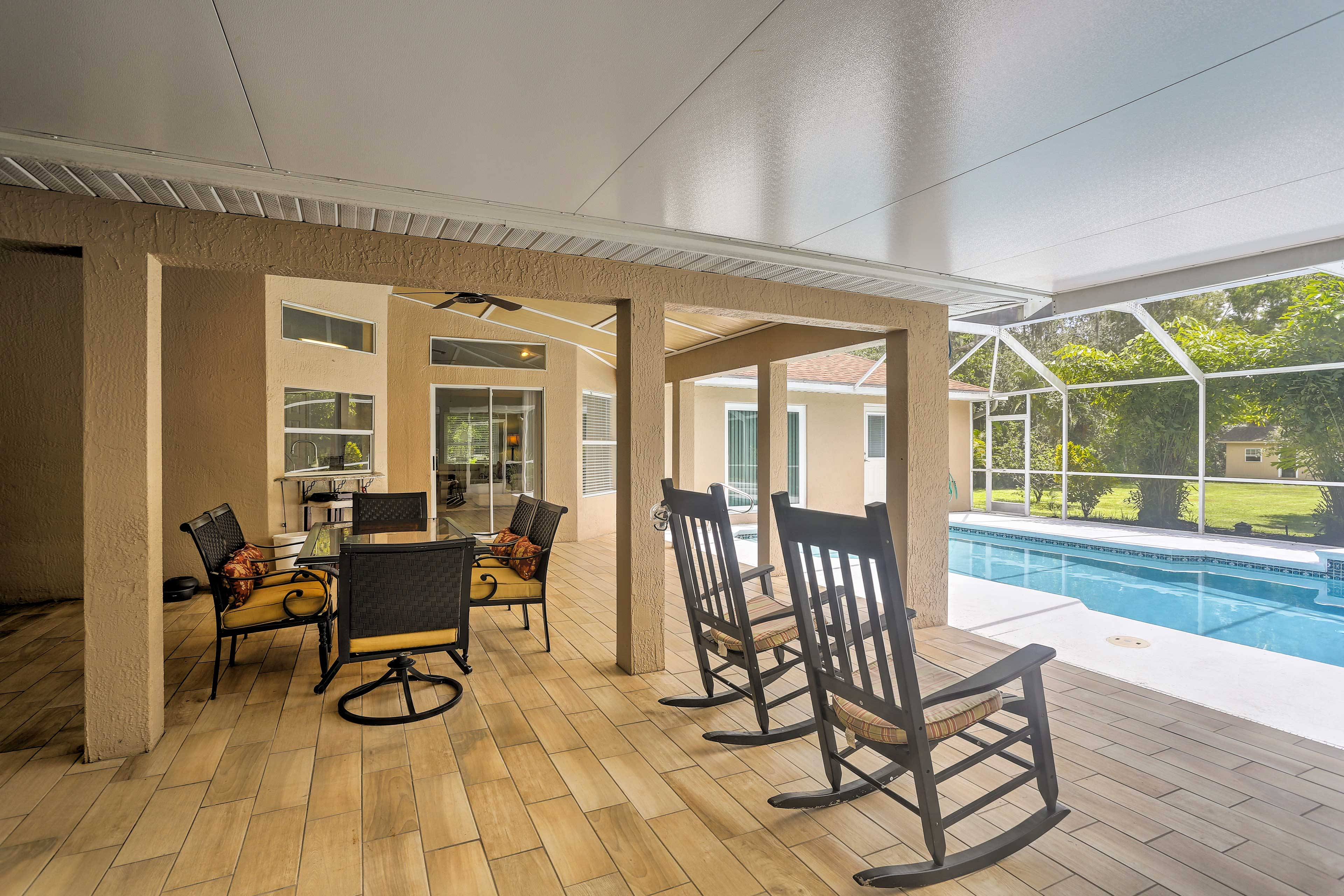 Lanai | Outdoor Dining Table | Rocking Chairs | Ceiling Fan
