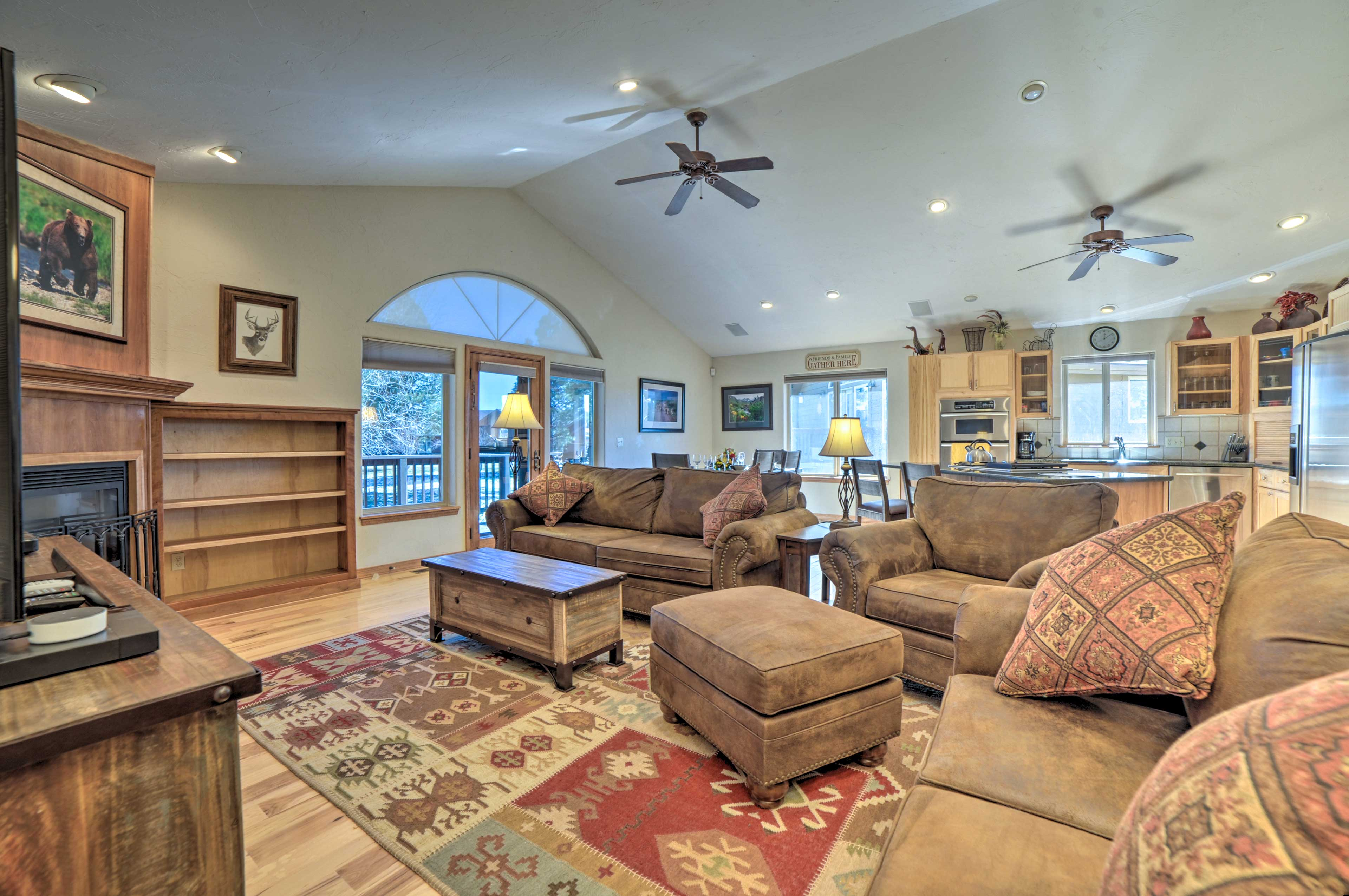 The living room is complete with plush furniture.