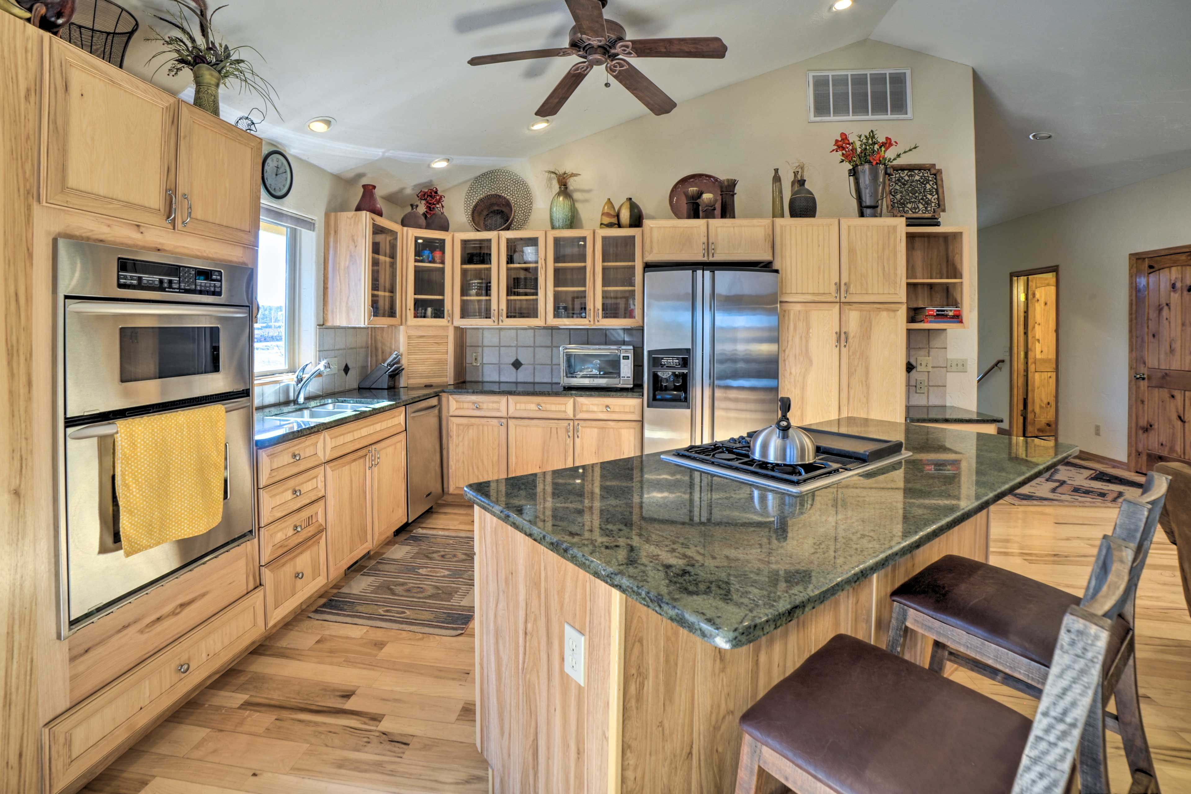 The fully equipped kitchen is complete with stainless steel appliances.