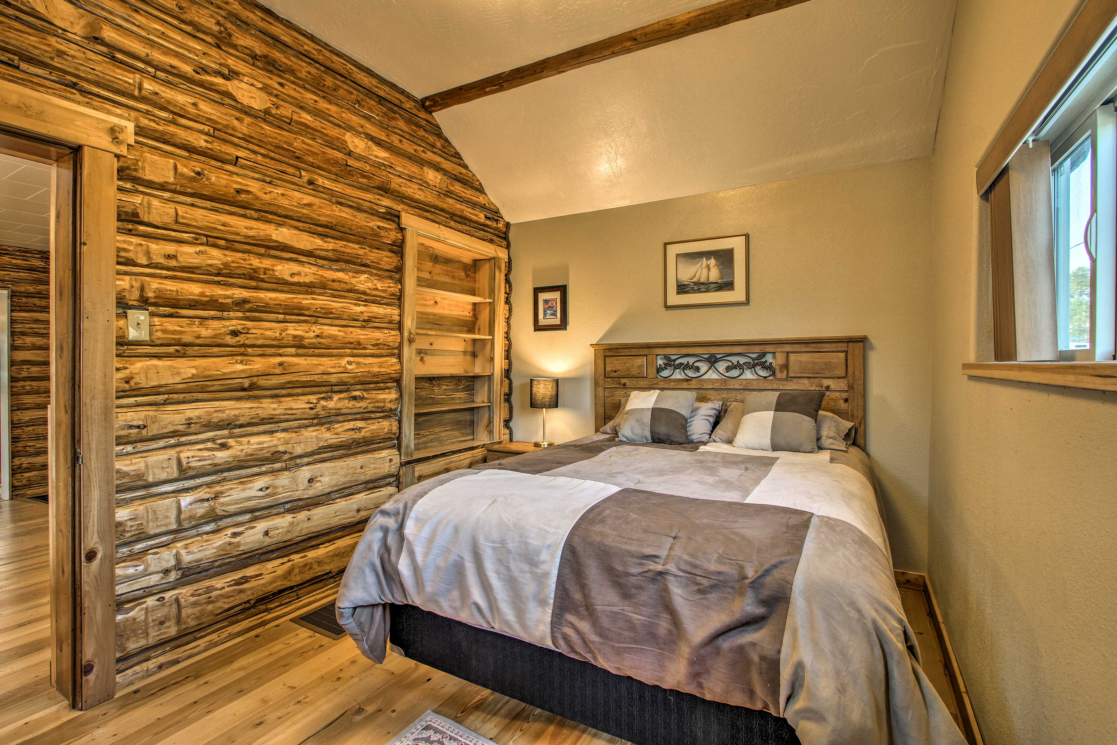 Relax on the queen bed in the first bedroom.