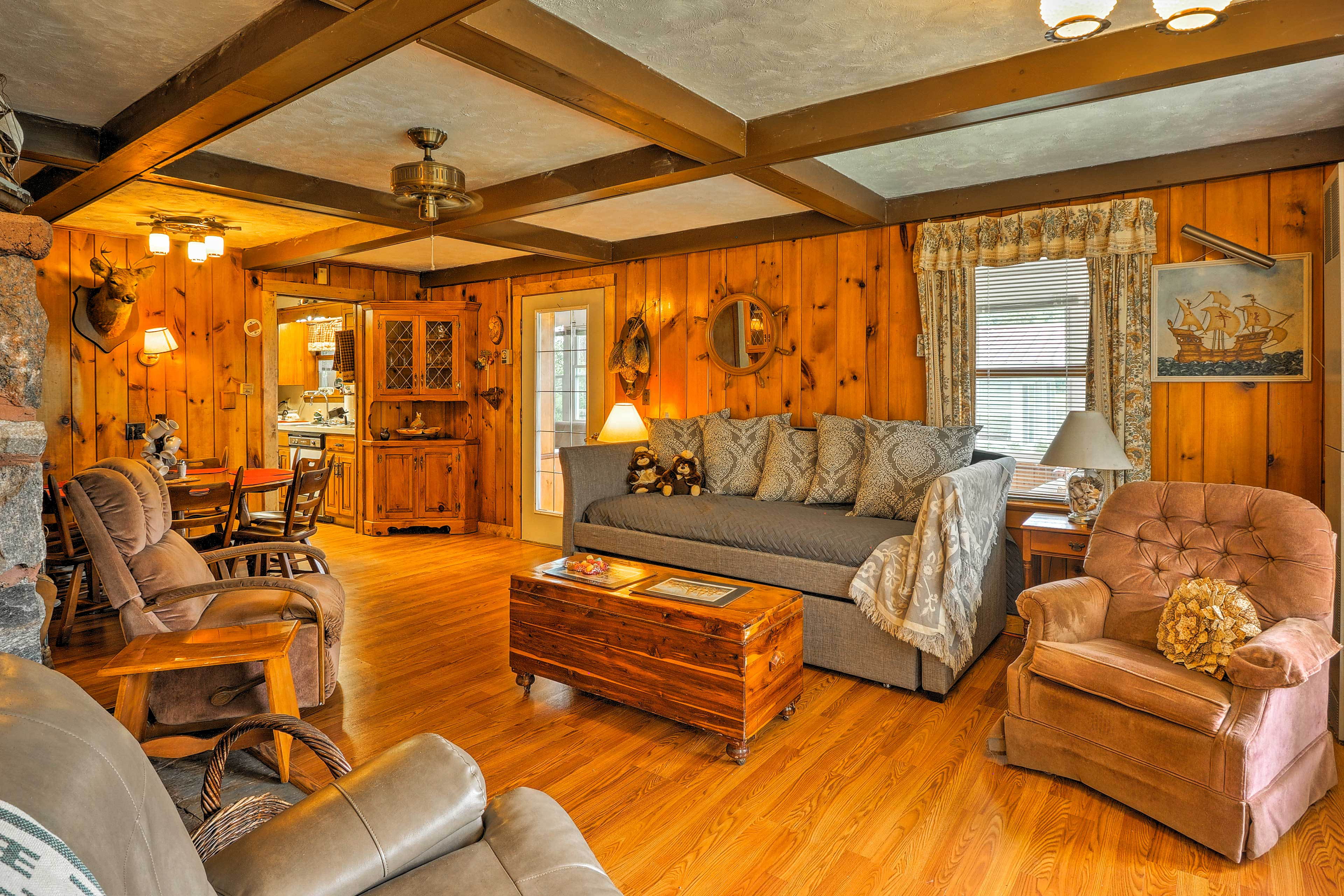 The living room has a twin bed, a twin trundle bed, and a flat-screen cable TV.