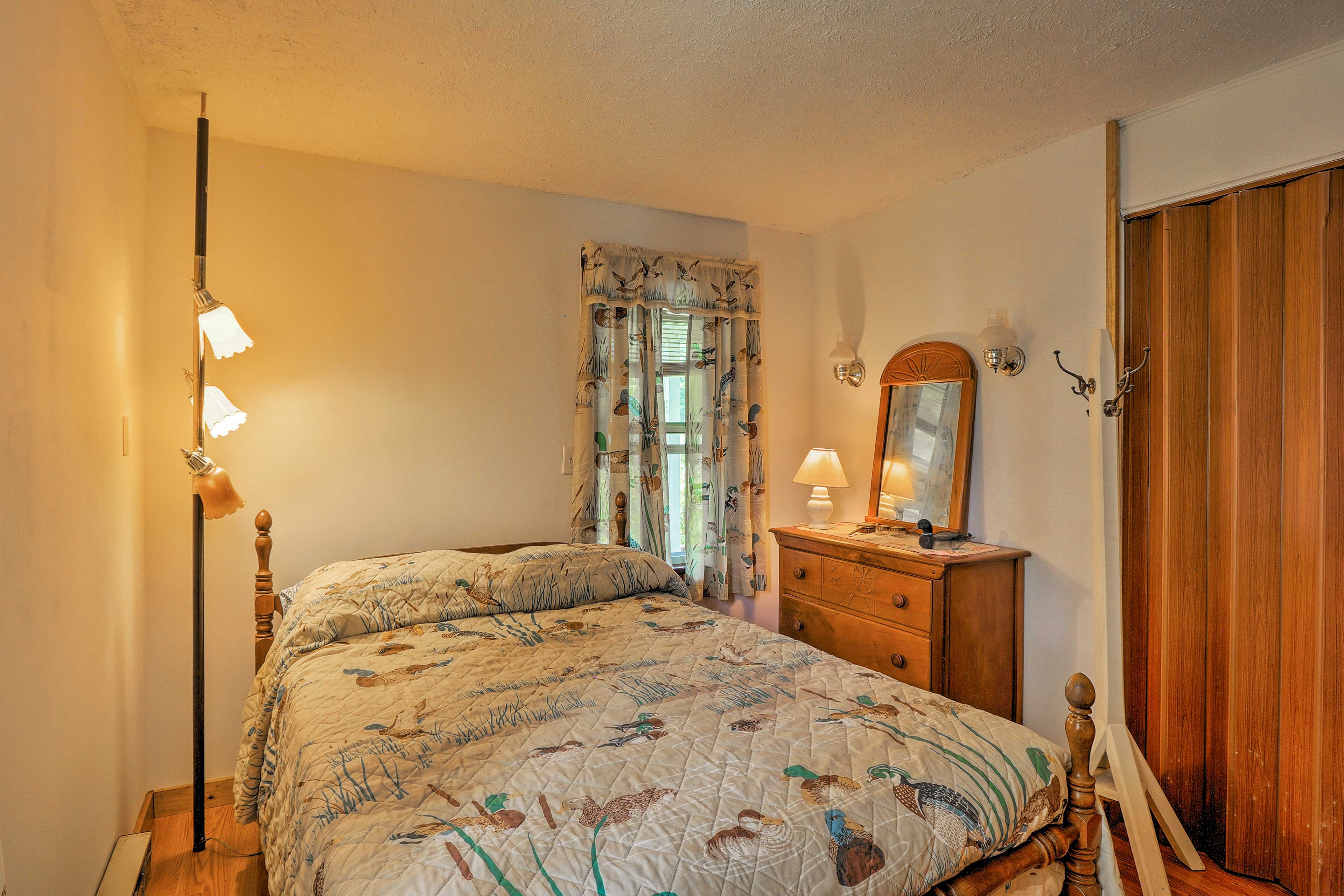 The property sleeps 8 in 2 bedrooms, the windowed porch and living room.