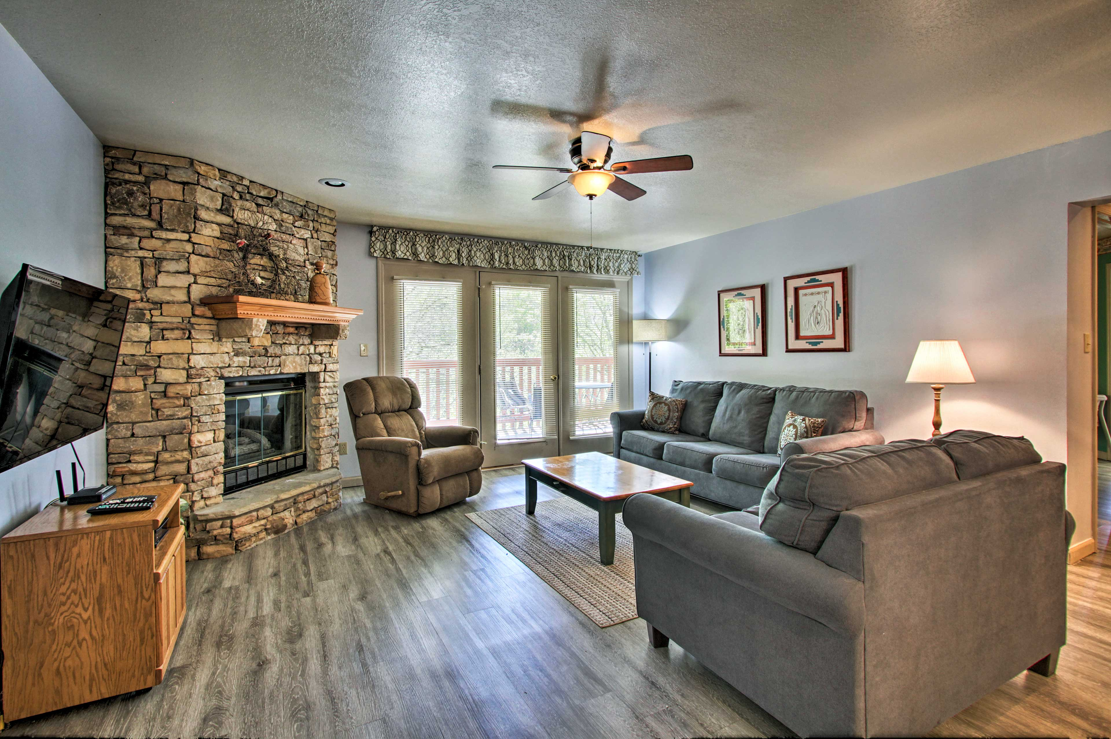 The interior features hardwood floors, a gas fireplace and an open layout.