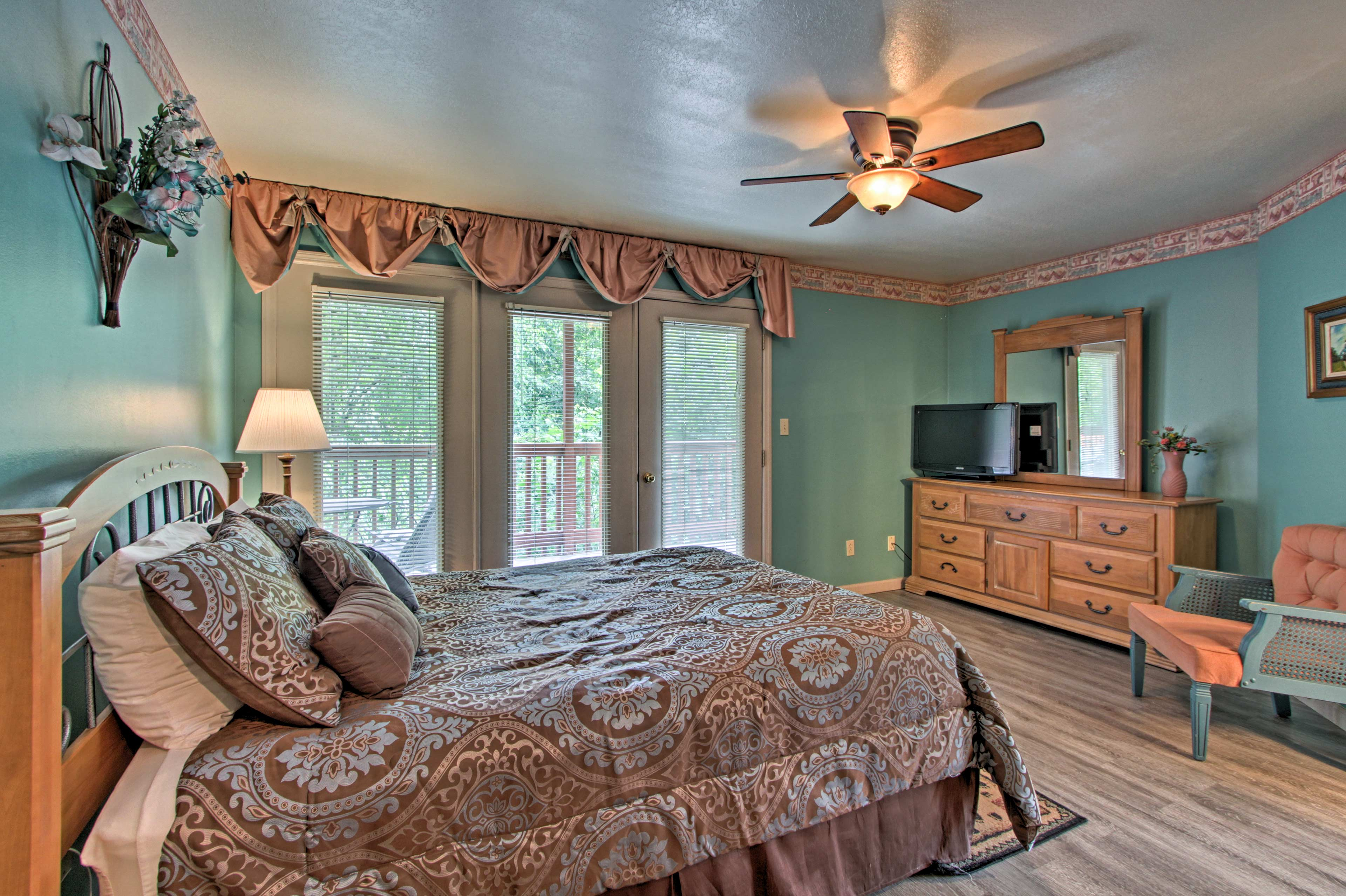 The master offers a queen bed, TV, and private access to the balcony.